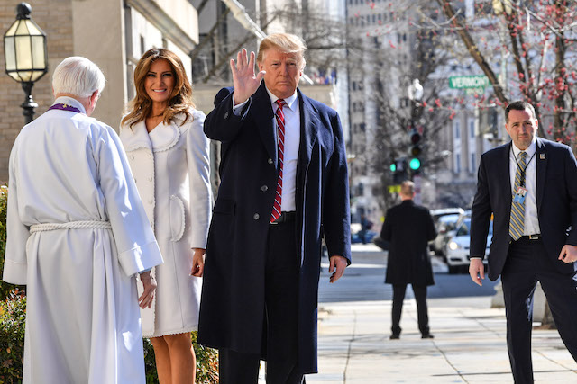 US President Donald Trump and First Lady Melania Trump (2nd L) are welcome by interim rector Bruce McPherson (L) as they arrive at St. Johns Episcopal church in Washington, DC, on March 17, 2019. (Photo credit: NICHOLAS KAMM/AFP/Getty Images)