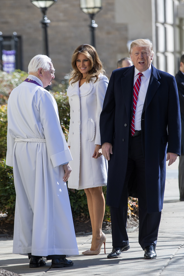 U.S. President Donald J. Trump (R) and first lady Melania Trump (C) are greeted by Reverend W. Bruce McPherson (L) as they arrive to attend services at St. John's Episcopal Church March 17, 2019 in Washington, DC, USA. The Trumps are attending church on St. Patrick's Day. (Photo by Eric Lesser - Pool/Getty Images)