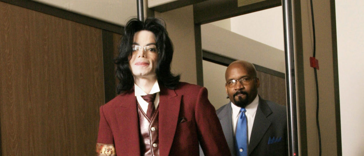 Michael Jackson passes through security as he arrives for his child molestation trial at the Santa Barbara County Courthouse April 27, 2005 in Santa Maria, California. Jackson is charged in a 10-count indictment with molesting a boy, plying him with liquor and conspiring to commit child abduction, false imprisonment and extortion. (Photo by Eric Neitze-PoolGetty Images)