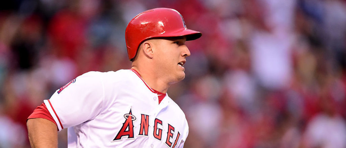 ANAHEIM, CA - MAY 28: Mike Trout #27 of the Los Angeles Angels watches his solo homerun to tie the score 1-1 with the Houston Astros during the first inning at Angel Stadium of Anaheim on May 28, 2016 in Anaheim, California. (Photo by Harry How/Getty Images)
