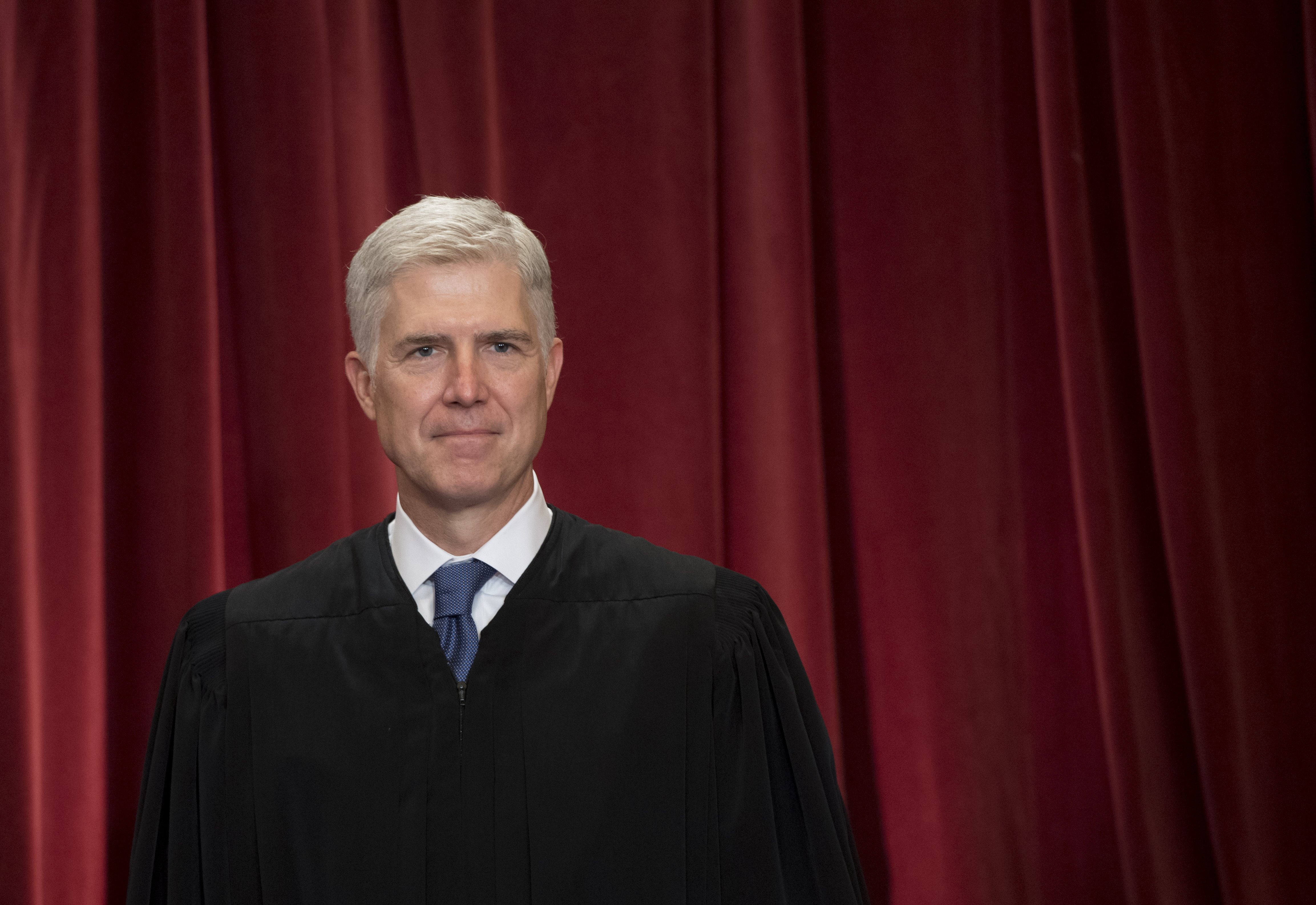 Justice Neil Gorsuch stands for an official photo with other members of the Supreme Court on June 1, 2017. (Saul Loeb/AFP/Getty Images)