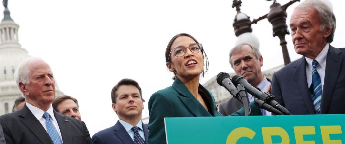 "FILE PHOTO: U.S. Representative Alexandria Ocasio-Cortez and Senator Ed Markey hold a news conference for their proposed ""Green New Deal"" to achieve net-zero greenhouse gas emissions in 10 years, at the U.S. Capitol in Washington, U.S., Feb. 7, 2019. REUTERS/Jonathan Ernst/File Photo"