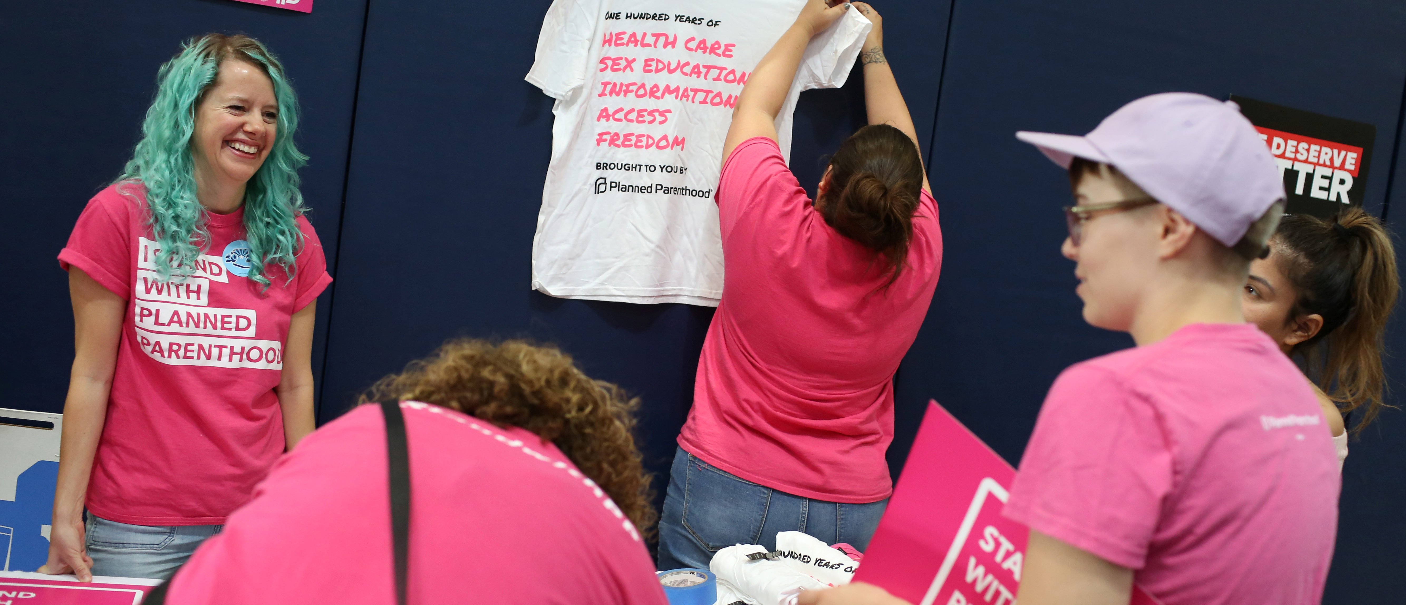 Volunteers with Planned Parenthood of Arizona set up at a bilingual healthcare town hall sponsored by local organizations that work in Latino voter outreach, disability advocacy and community health at the Ability360 Center in Phoenix, Arizona, U.S. July 5, 2017. Senators John McCain and Jeff Flake (R-AZ) were invited but declined to attend. Picture taken July 5, 2017. REUTERS/Caitlin O'Hara