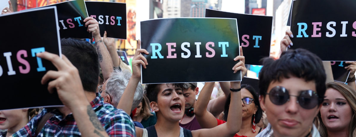 People attend a protest against U.S. President Donald Trump's announcement that he plans to reinstate a ban on transgender individuals from serving in any capacity in the U.S. military, in Times Square, in New York City, New York, U.S., July 26, 2017. REUTERS/Carlo Allegri