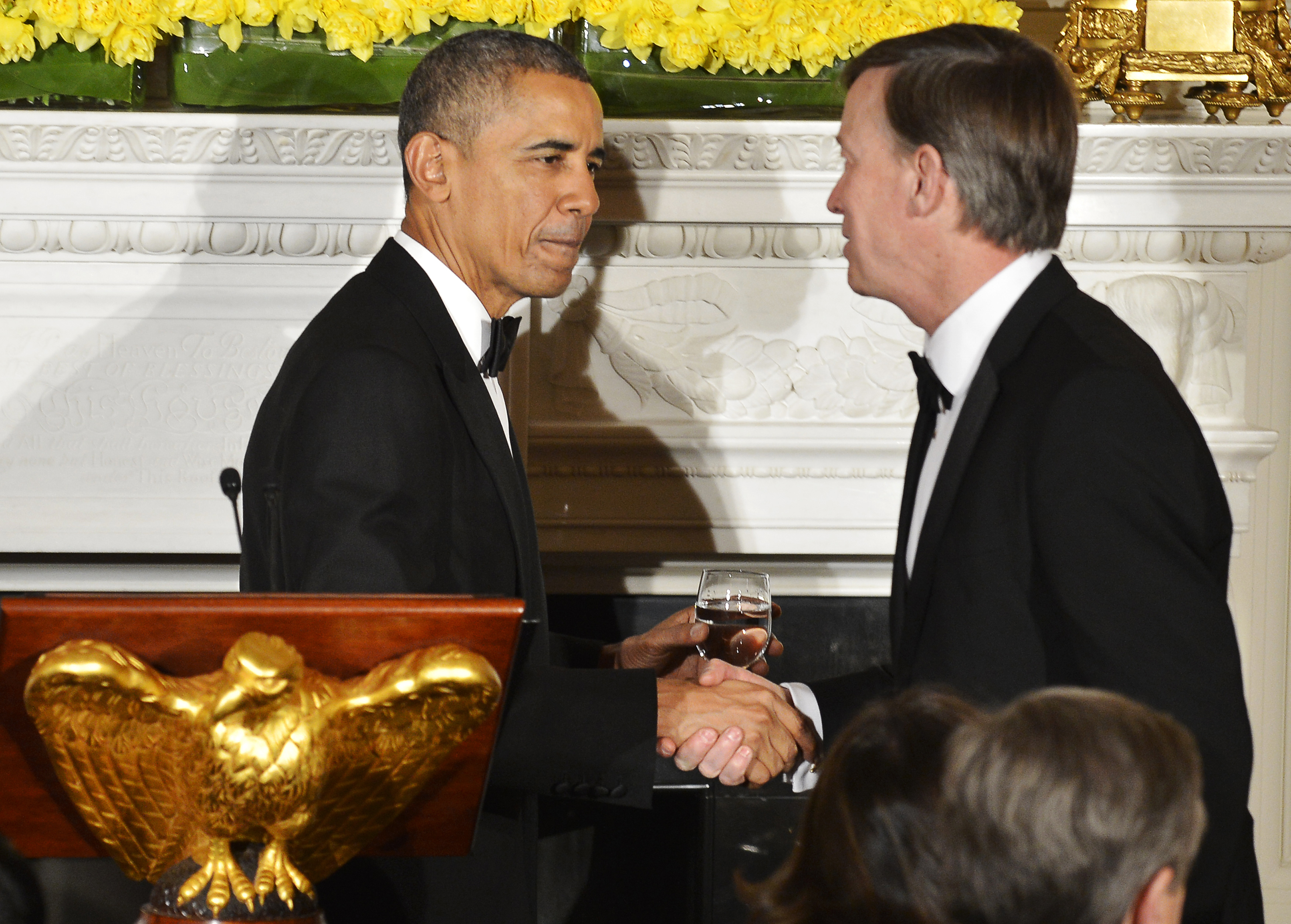 U.S. President Obama shakes hands with National Governors Association Chairman Hickenlooper after a toast at the White House