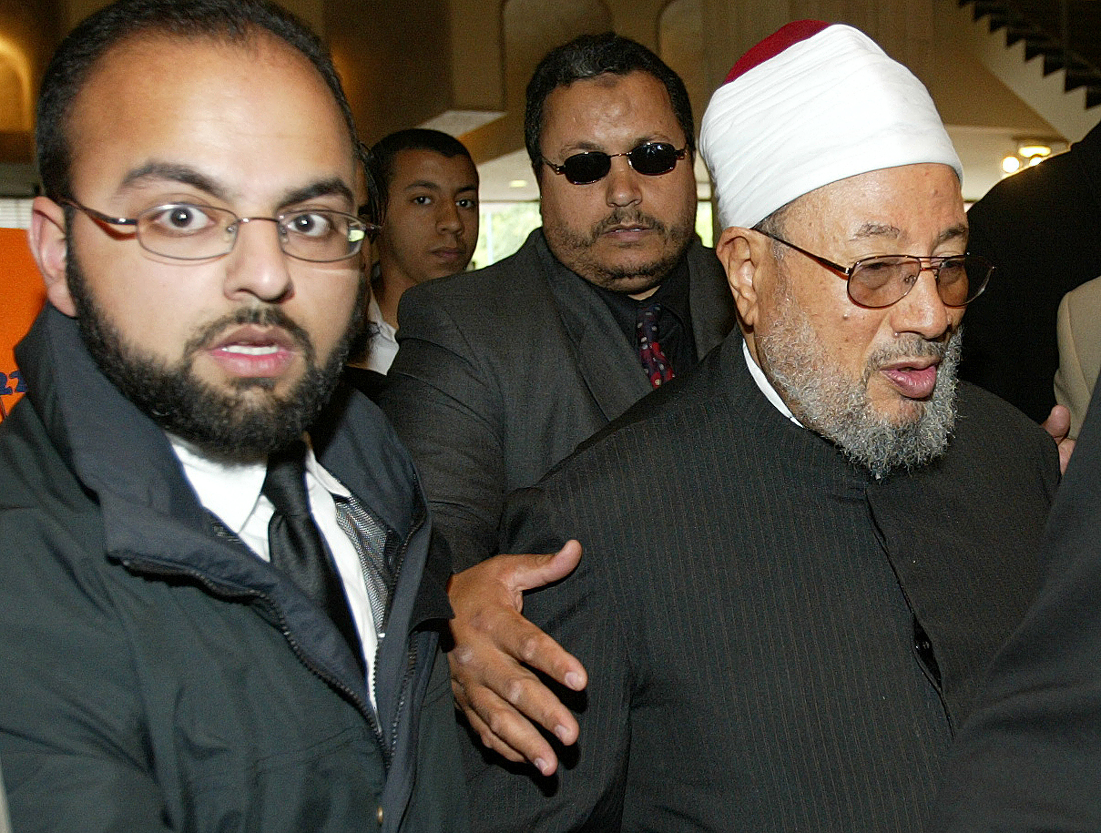 Egyptian-born Muslim cleric Yusuf Al-Qaradawi (R) arrives at the Wembley conference centre, London, July 11, 2004 before addressing a conference on education.(REUTERS/Michael Crabtree)