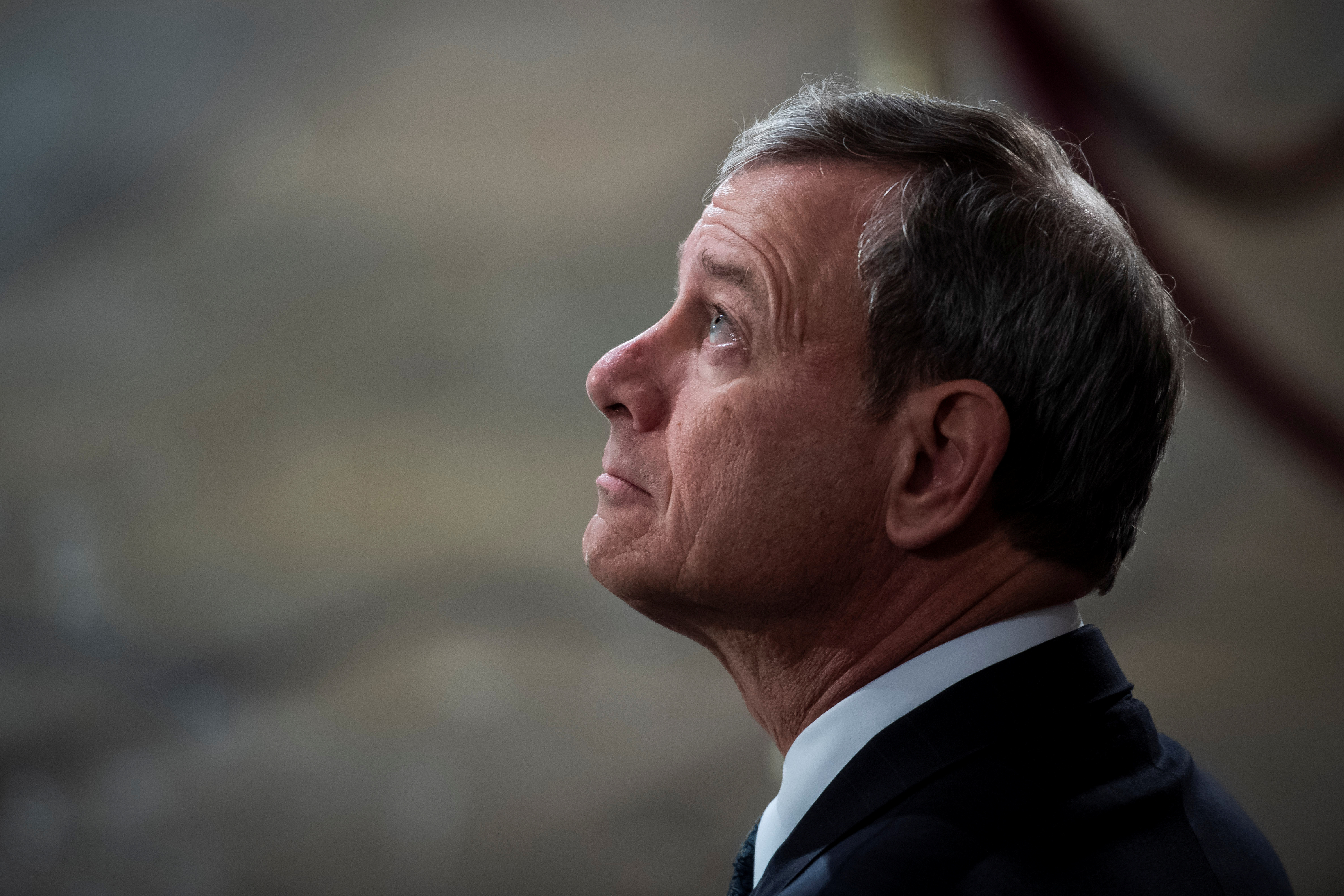 Supreme Court Chief Justice of the United States John G. Roberts, Jr. waits for the arrival of Former president George H.W. Bush to lie in State at the U.S. Capitol Rotunda on Capitol Hill on Monday, Dec. 03, 2018 in Washington, DC. Jabin Botsford/Pool via Reuters