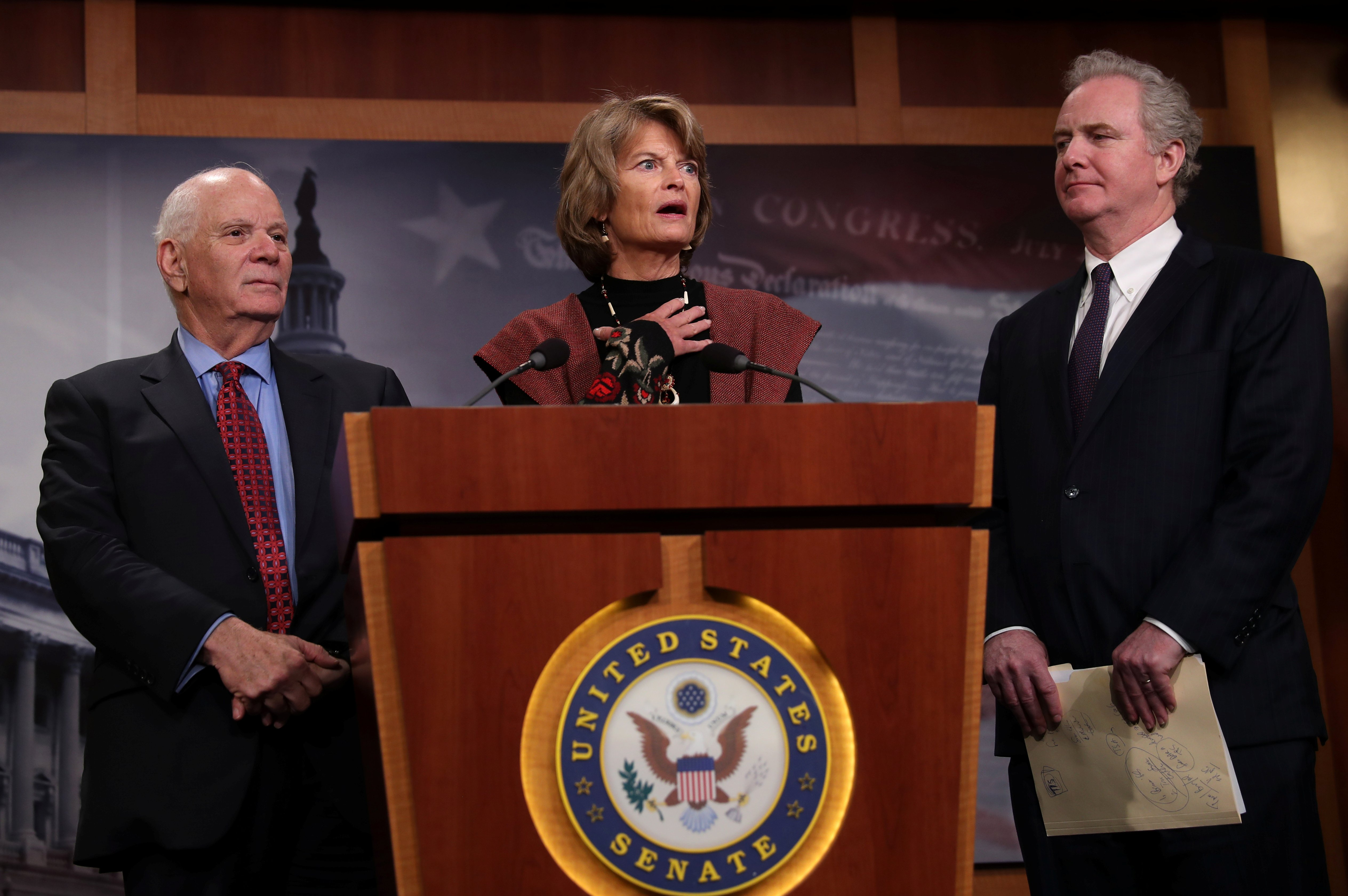 Sens. Ben Cardin (D-MD) (L), Lisa Murkowski (R-AK) (C) and Chris Van Hollen (D-MD) hold a press conference in Washington