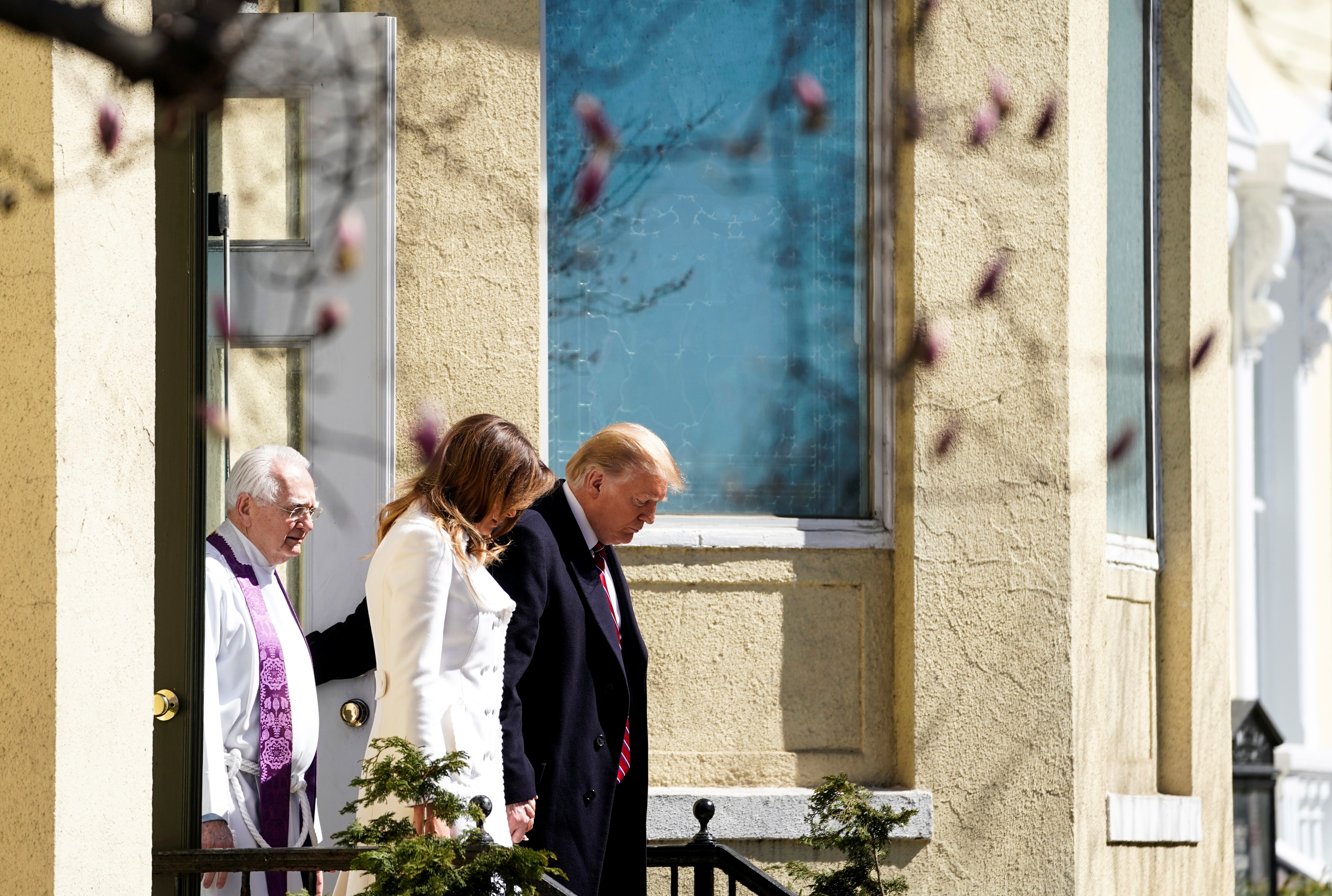 U.S. President Donald Trump and U.S. first lady Melania Trump walk with Interim Rector Reverend Bruce McPherson as they depart from St. John's Episcopal Church in Washington, U.S., March 17, 2019. REUTERS/Joshua Roberts