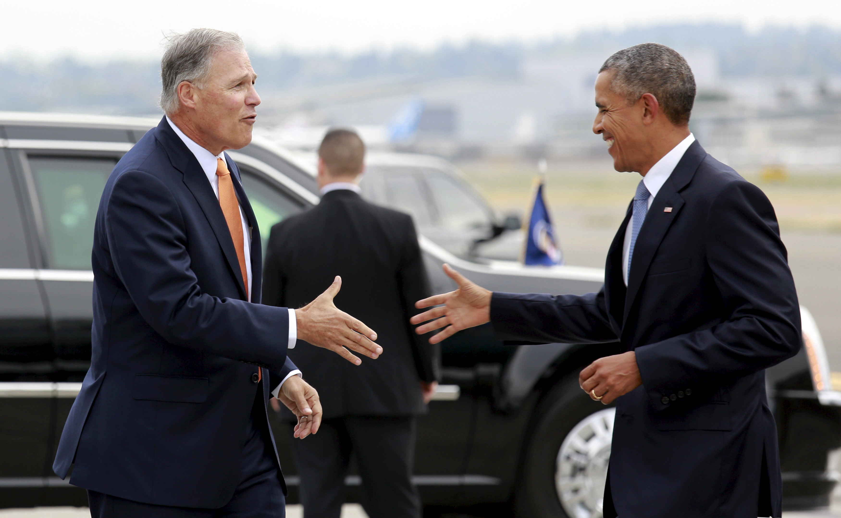 U.S. President Obama is welcomed by Washington Governor Inslee upon his arrival in Seattle, Washington