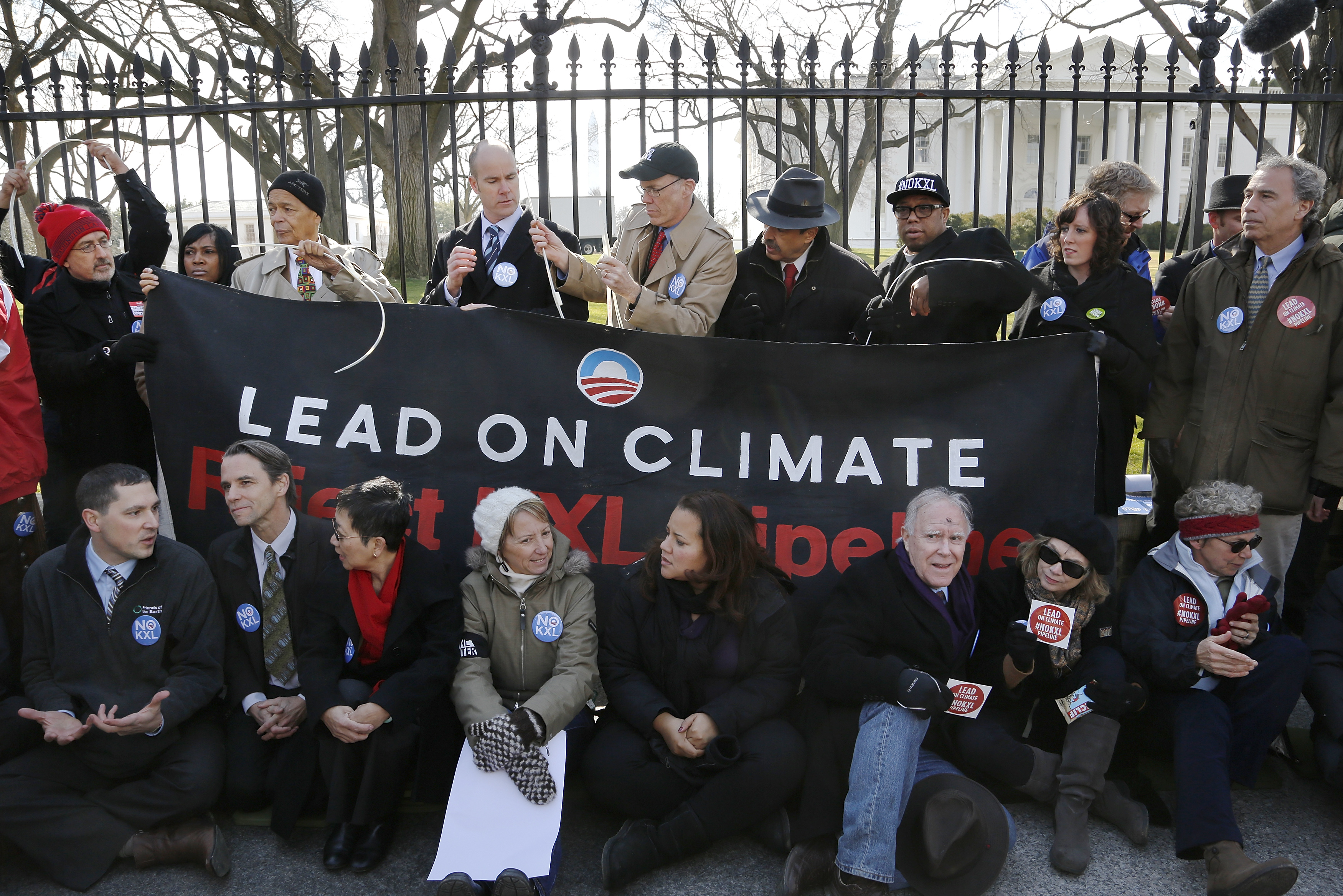 Activists opposed to the Keystone XL tar sands pipeline project tie themselves to the White House fence during an environmental protest in Washington
