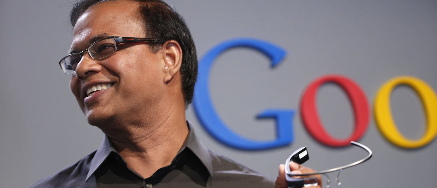Amit Singhal, senior vice president of search at Google, holds a Google Glass as he speaks at the garage where the company was founded on Google's 15th anniversary in Menlo Park, California September 26, 2013. (REUTERS/Stephen Lam)