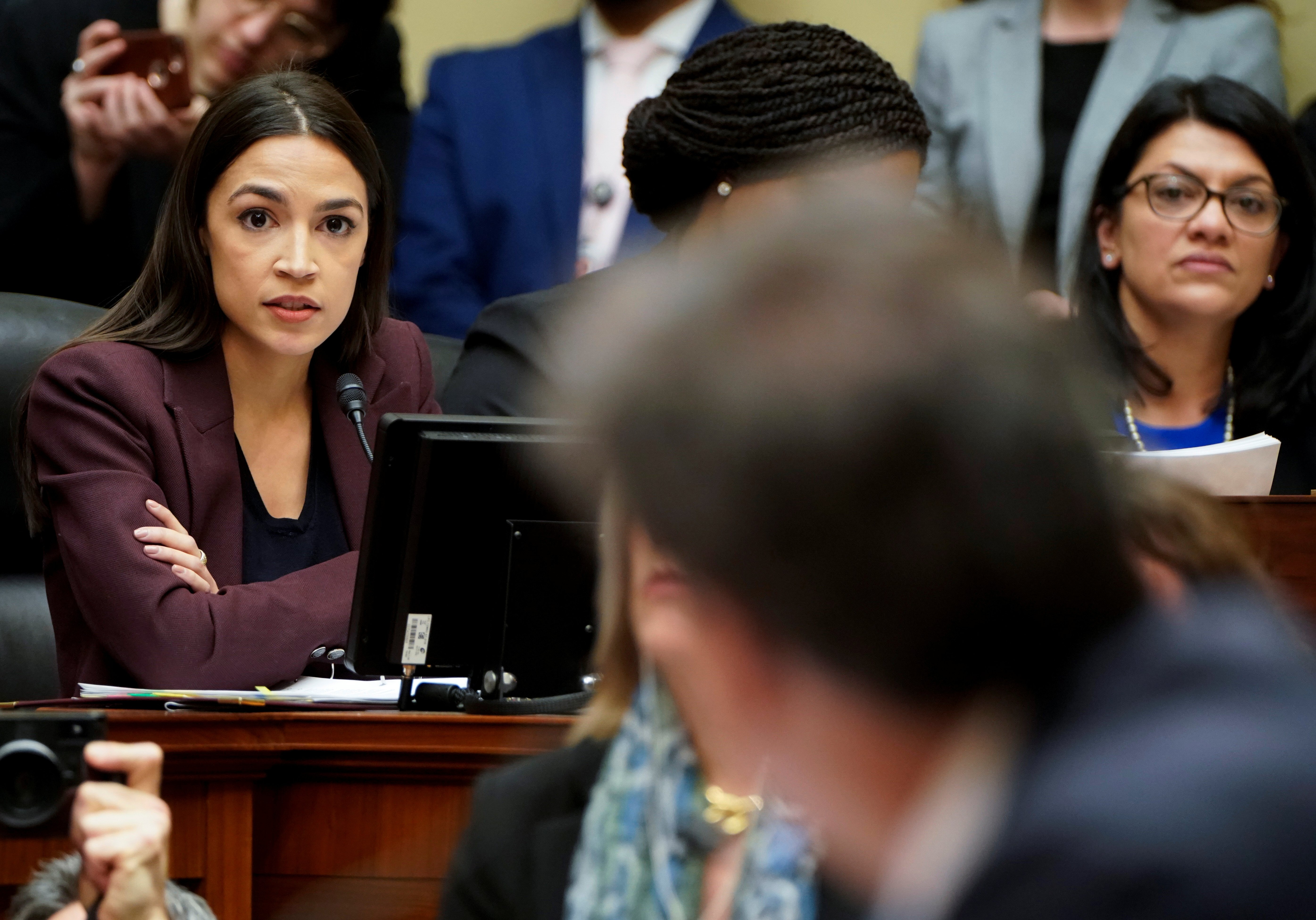 U.S. Rep. Alexandria Ocasio-Cortez (D-NY) questions Michael Cohen, the former personal attorney of U.S. President Donald Trump, as he testifies before a House Committee on Oversight and Reform hearing on Capitol Hill in Washington, U.S., February 27, 2019. REUTERS/Joshua Roberts