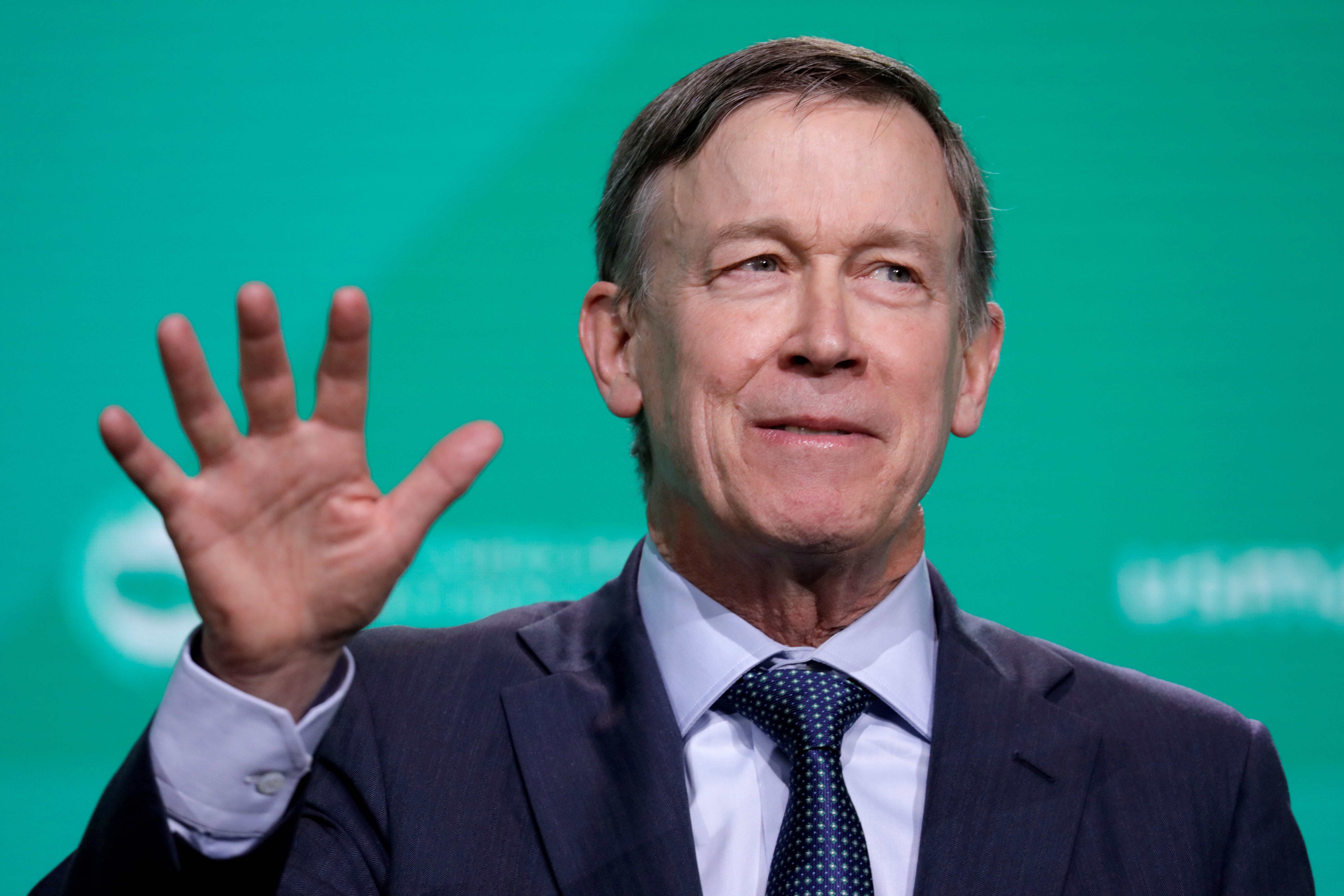 Former Gov. John Hickenlooper speaks at the United States Conference of Mayors winter meeting in Washington
