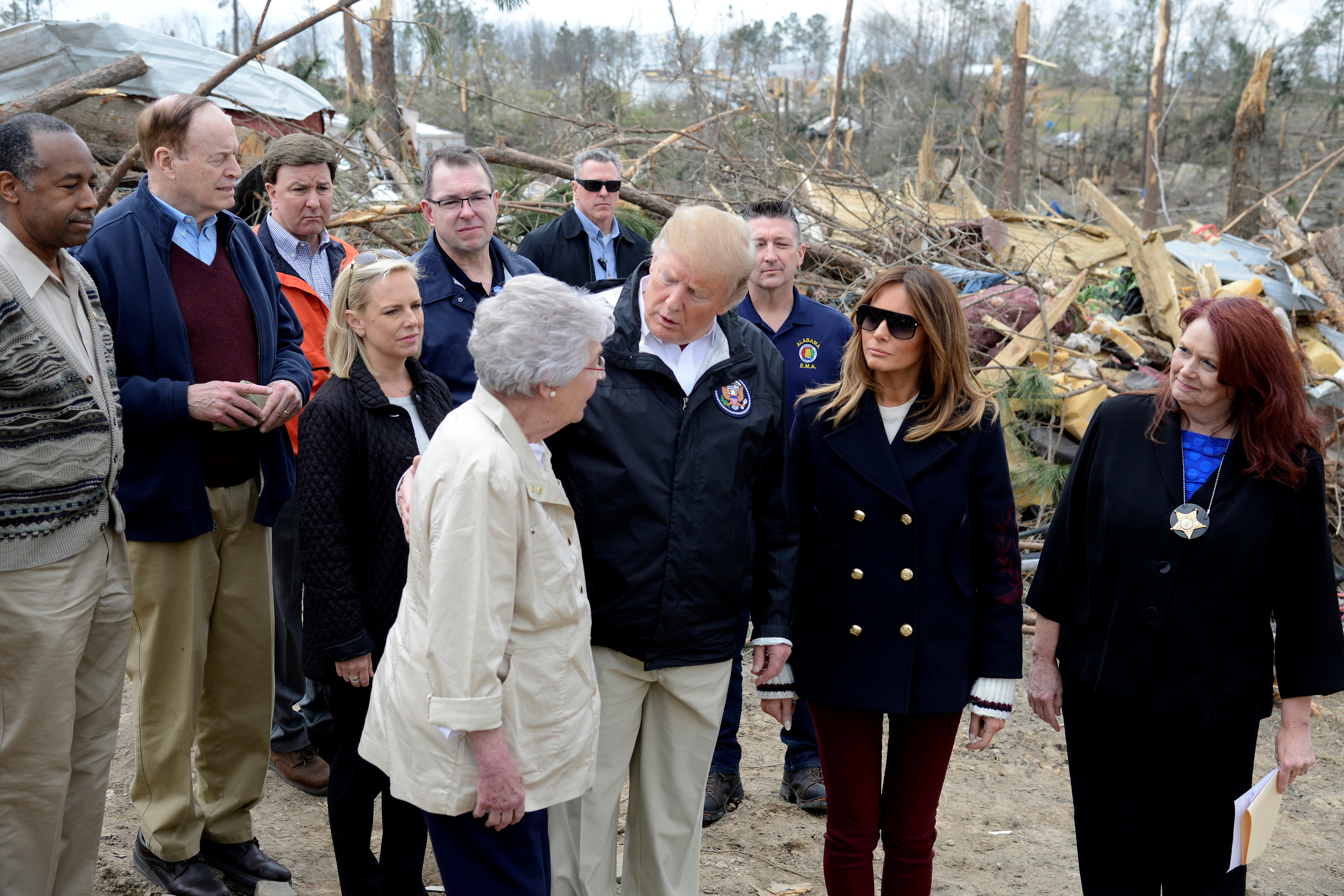 U.S. President Donald Trump and First Lady Melania Trump chat with Alabama Gov. Kay Ivey as they survey damage by a tornado with a FEMA official, along with HHS Secretary Ben Carson, Sen. Richard Shelby (R-AL) and DHS Secretary Kirstjen Nielsen, in Beauregard, Alabama, U.S., March 8, 2019. REUTERS/Mike Theiler
