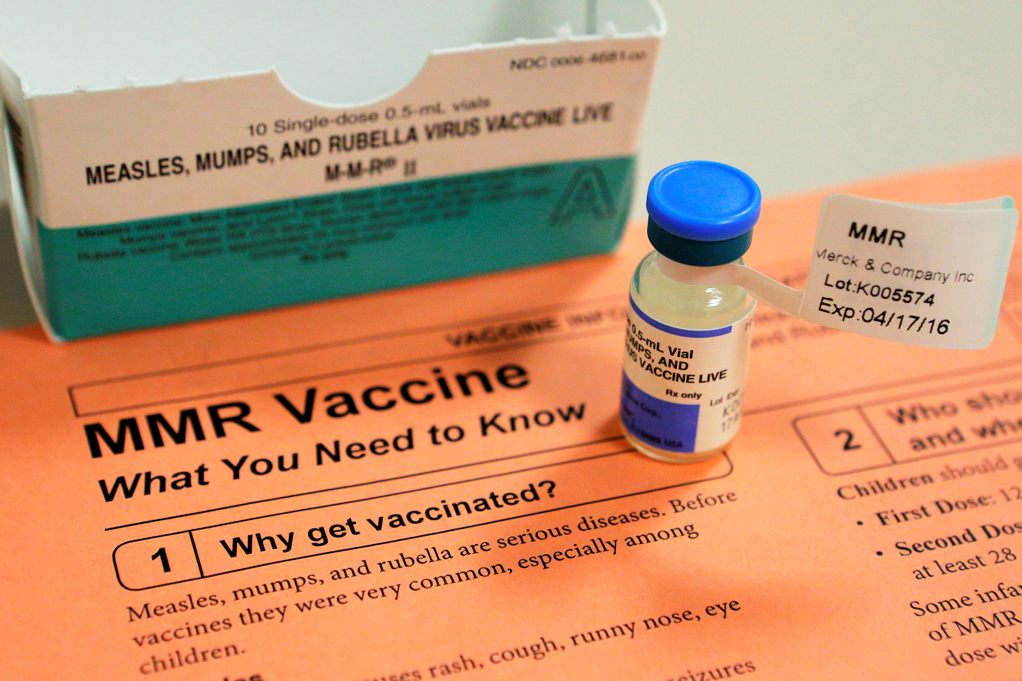 A vial of measles, mumps and rubella vaccine and an information sheet is seen at Boston Children's Hospital in Boston, Massachusetts February 26, 2015. (REUTERS/Brian Snyder)