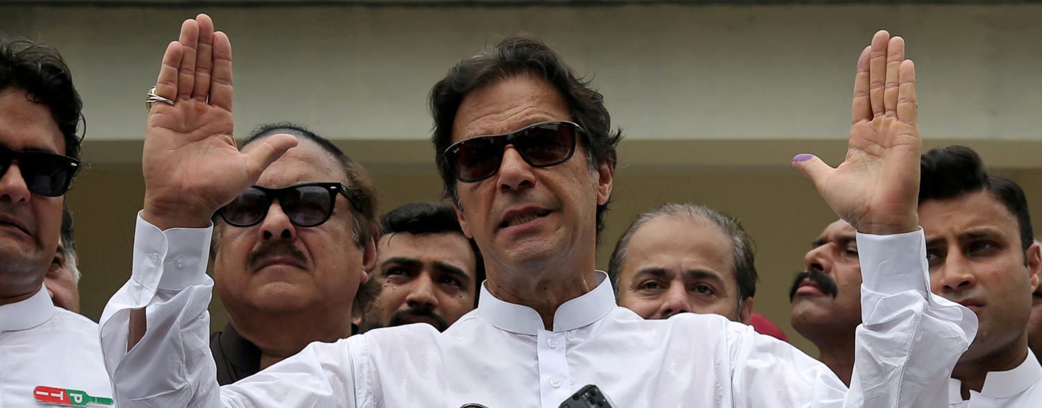 Cricket star-turned-politician Imran Khan, chairman of Pakistan Tehreek-e-Insaf (PTI), speaks after voting in the general election in Islamabad, July 25, 2018. REUTERS/Athit Perawongmetha/File Photo