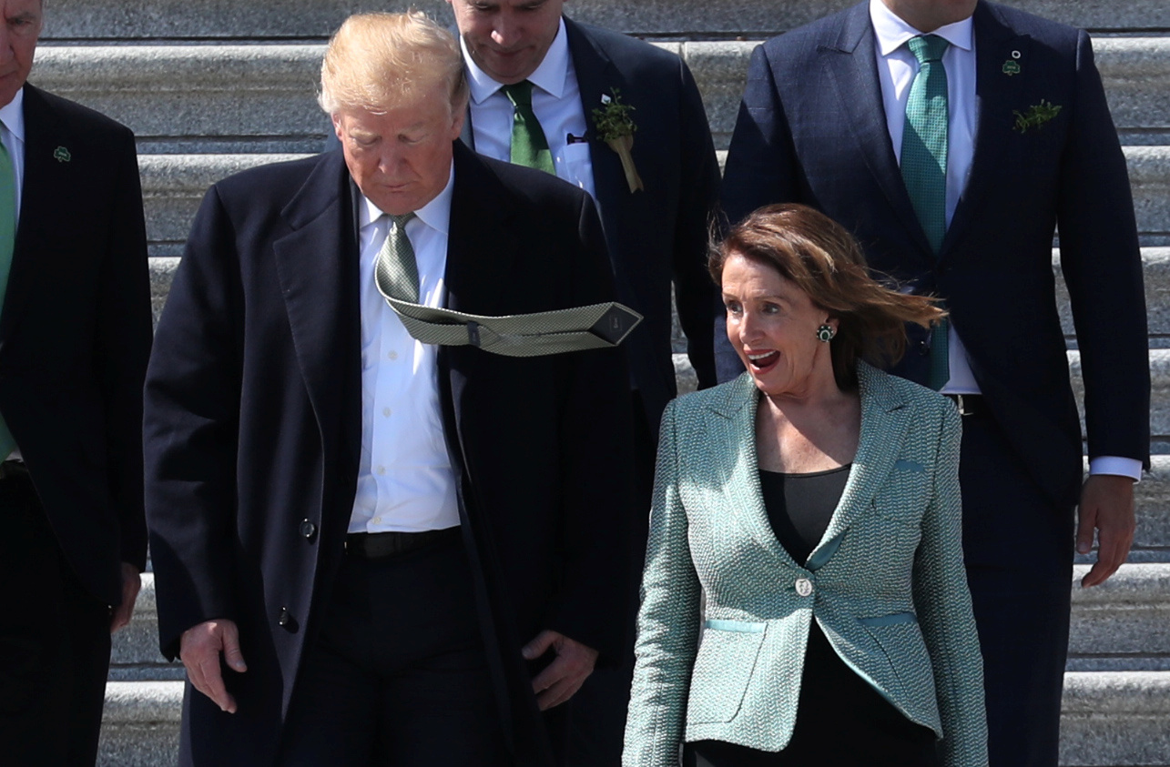 U.S. President Trump walks down Capitol steps with Speaker of the House Pelosi after they attended luncheon at U.S. Capitol in Washington