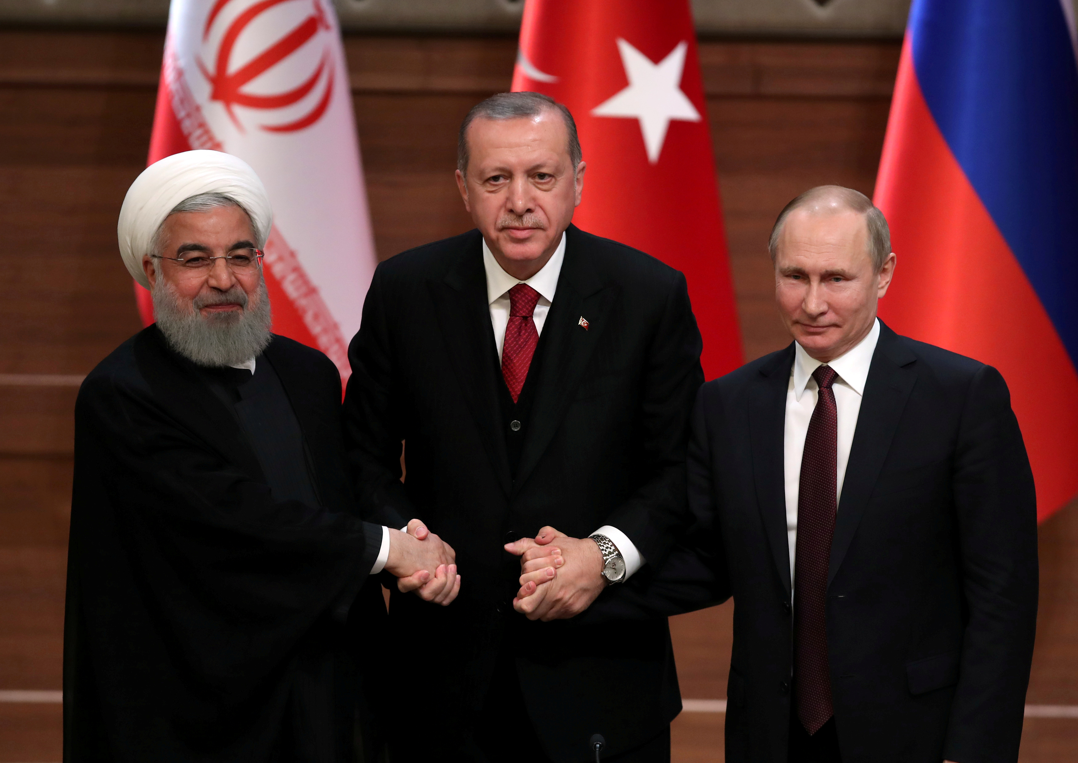 FILE PHOTO: Presidents Hassan Rouhani of Iran, Tayyip Erdogan of Turkey and Vladimir Putin of Russia hold a joint news conference after their meeting in Ankara, Turkey April 4, 2018. REUTERS/Umit Bektas/File Photo
