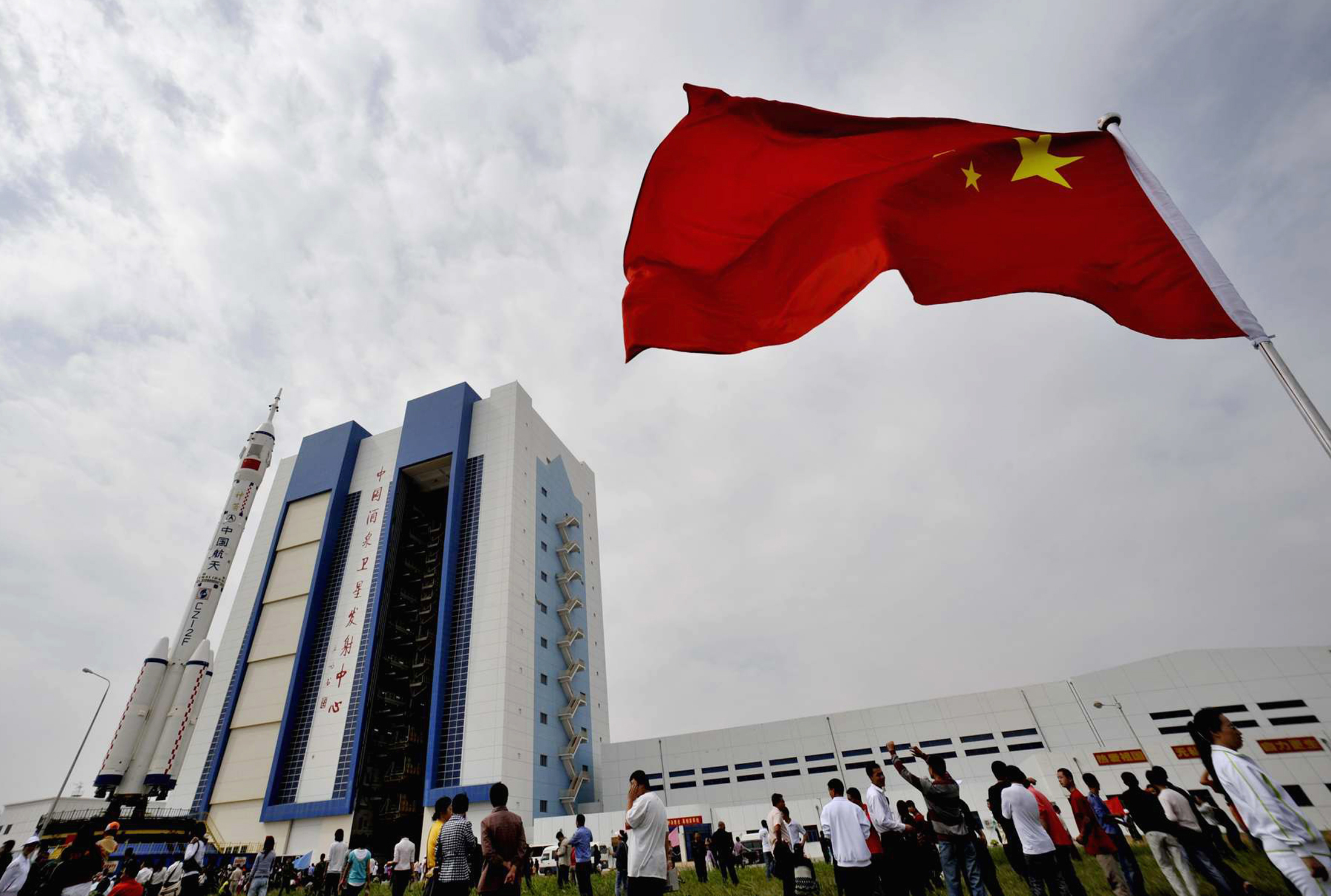 The Shenzhou-7 manned spaceship, the Long-March II-F rocket and the escape tower are transferred to the launch pad at the Jiuquan Satellite Launch Center, Gansu province September 20, 2008. Astronauts readying for China's next leap into space have arrived at the launch site of the Shenzhou 7 craft, official media reported, as enthusiasm grew over the Olympic host nation's next attention-grabbing feat. Picture taken September 20, 2008. REUTERS/China Daily