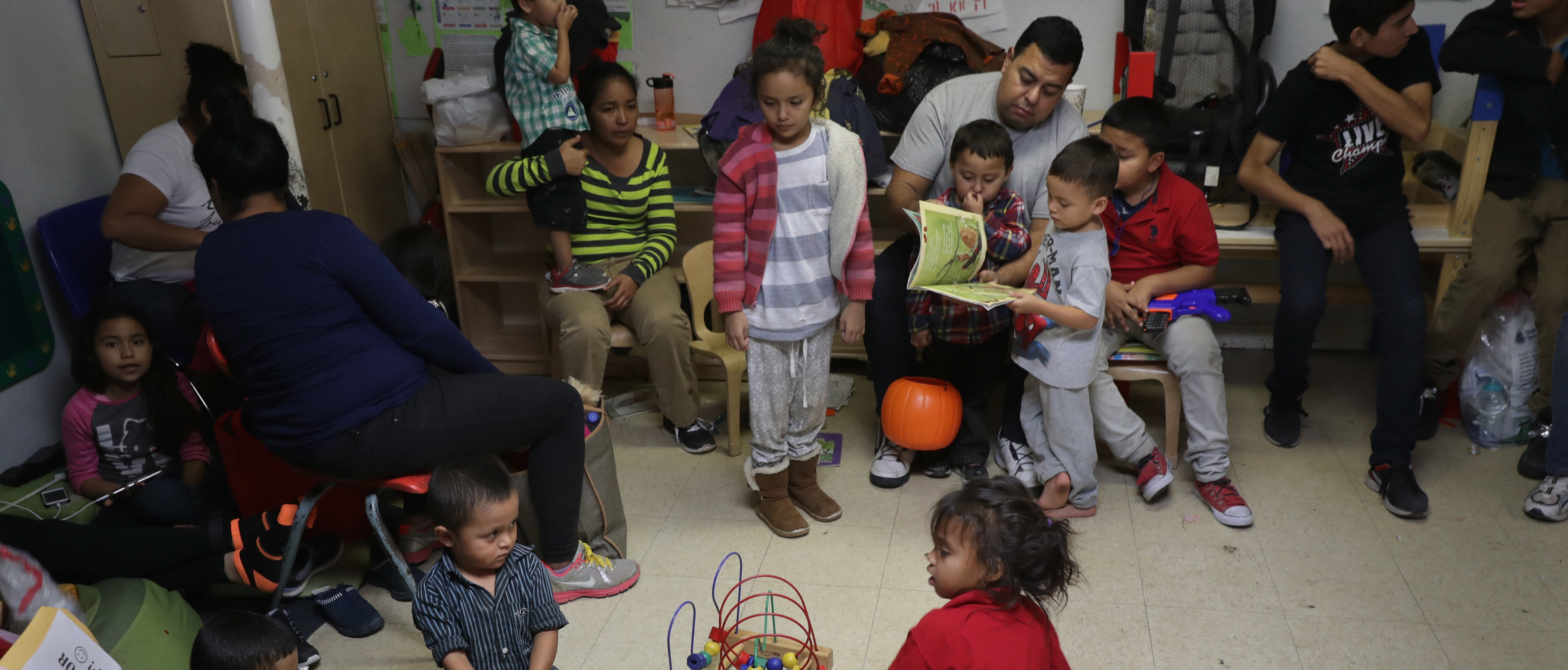 MCALLEN, TX - NOVEMBER 03: Immigrant children read and play at an aid center after being released from U.S. government detention on November 3, 2018 in McAllen, Texas. (Photo by John Moore/Getty Images)