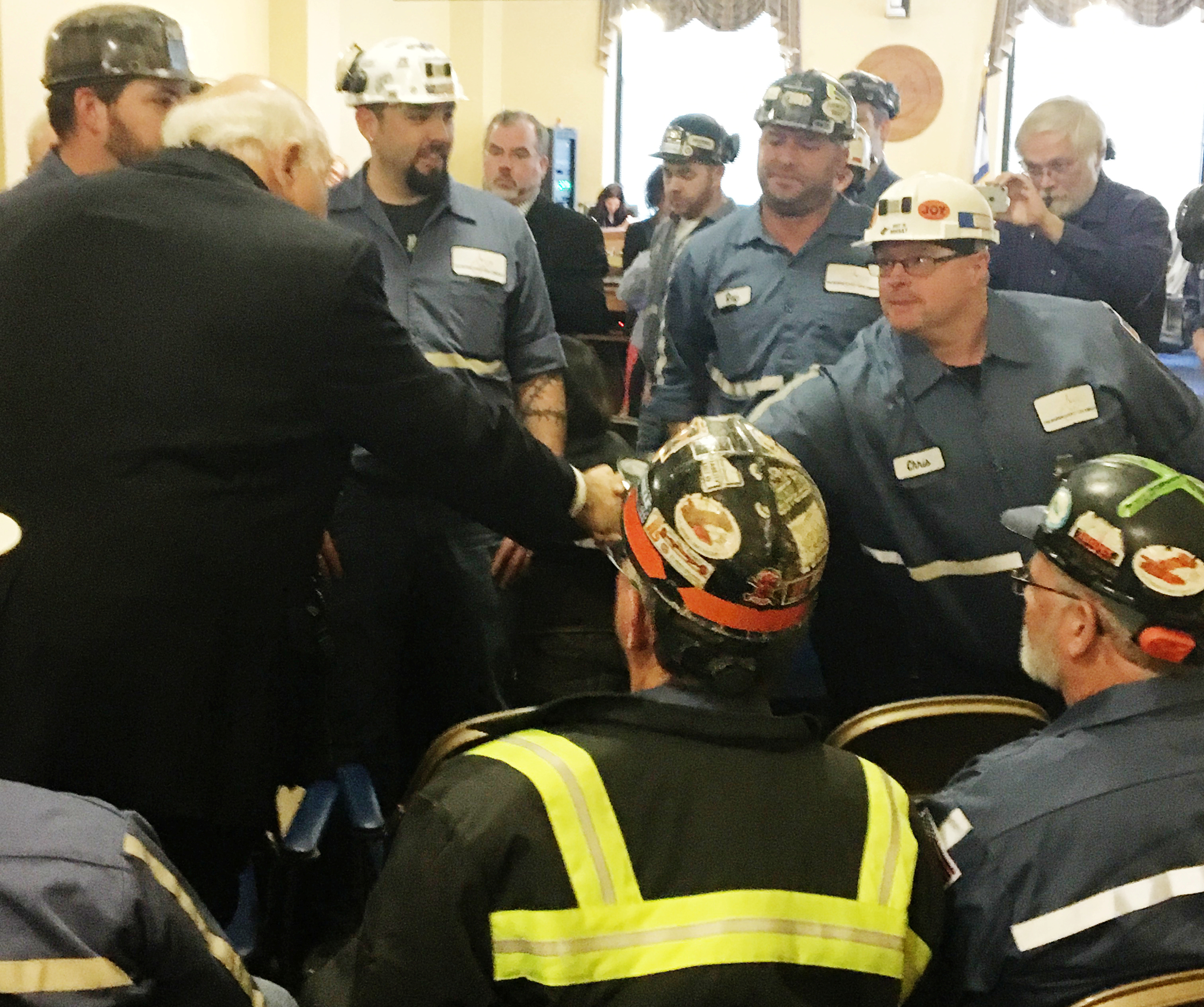 Robert Murray, founder and CEO of Murray Energy greets coal miners at the EPA hearing in Charleston, West Virginia, U.S. November 28, 2017 before speaking to the panel supporting the repeal of the Clean Power Plan. REUTERS/Kara Van Pelt
