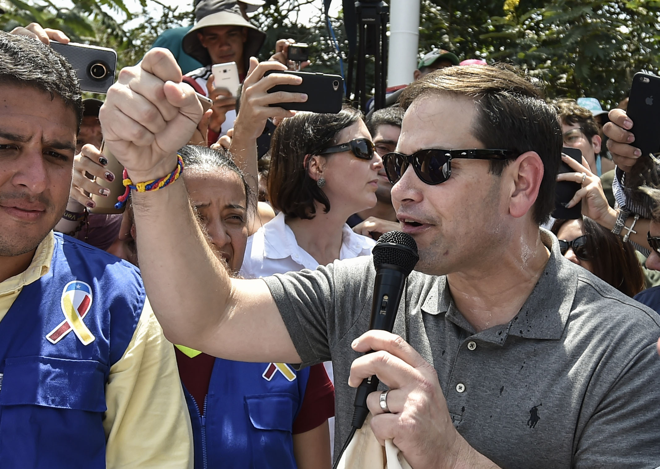 US senator Marco Rubio, addresses the press on the humanitarian aid shipments sent by the US government for Venezuela that are stockpiled at a collection center in the Colombian border, at the Simon Bolivar international bridge in Cucuta, Colombia, border with San Antonio de Tachira, Venezuela on February 17, 2019. - Thousands of volunteers in Venezuela will begin mobilizing on Sunday to bring American aid into their crisis-hit country despite a blockade by President Nicolas Maduro who claims the assistance could be cover for a US invasion. US aid that has been piling up in the Colombian border town of Cucuta has become the frontline of the confrontation between Guaido and Maduro. (Photo by Luis ROBAYO / AFP) (Photo credit should read LUIS ROBAYO/AFP/Getty Images)