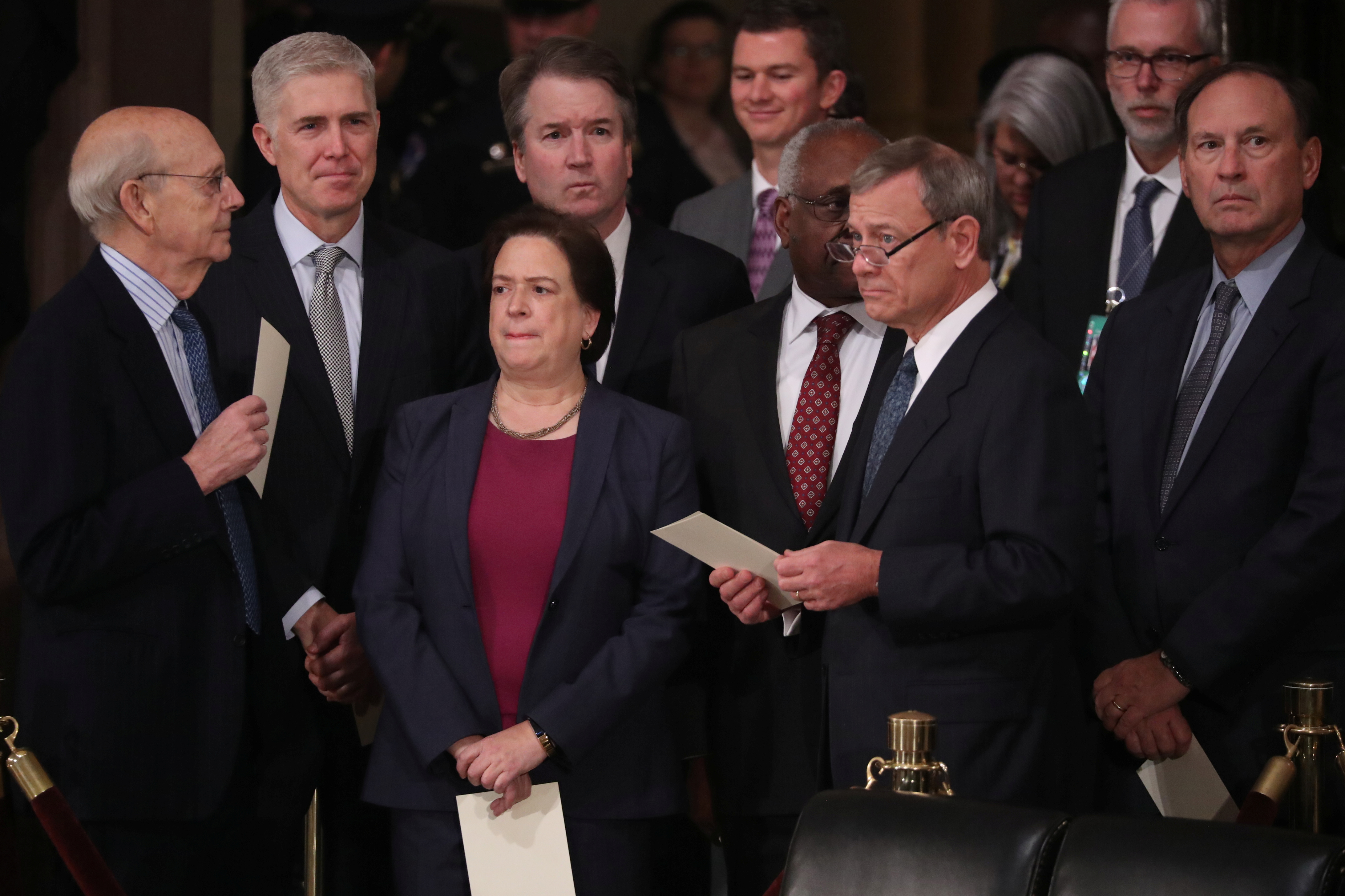 The justices of the Supreme Court await the arrival of the casket of former President George H.W. Bush inside the U.S. Capitol Rotunda on December 3, 2018 (REUTERS/Jonathan Ernst)
