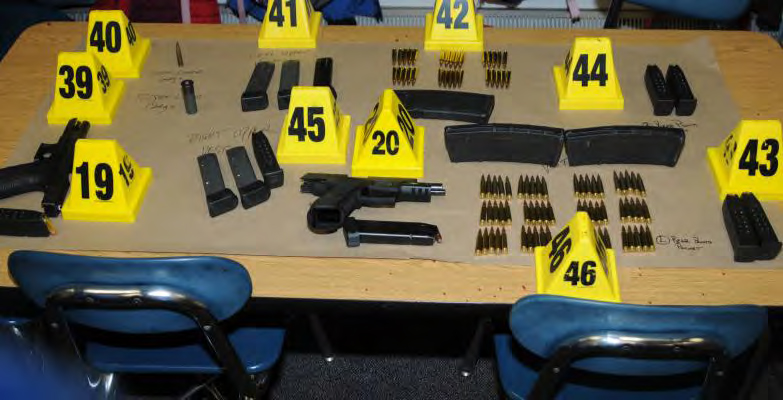 This handout crime scene photo provided by the Connecticut State Police shows firearms and ammunition found on or in close proximity to shooter's body at Sandy Hook Elementary School following the December 14, 2012 rampage (Connecticut State Police via Getty Images)