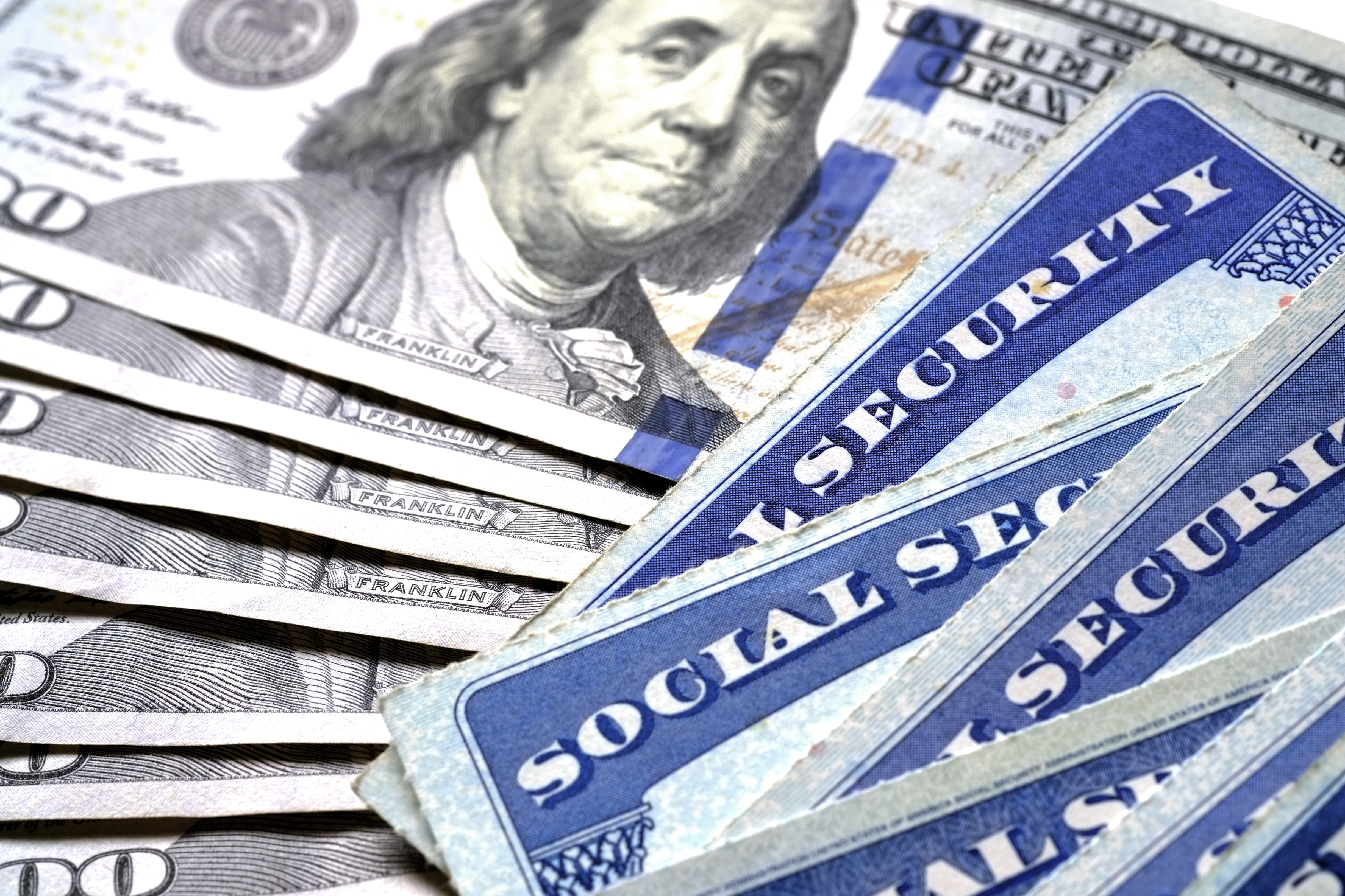 Pictured are social security cards and money. SHUTTERSTOCK/ Lane V. Erickson
