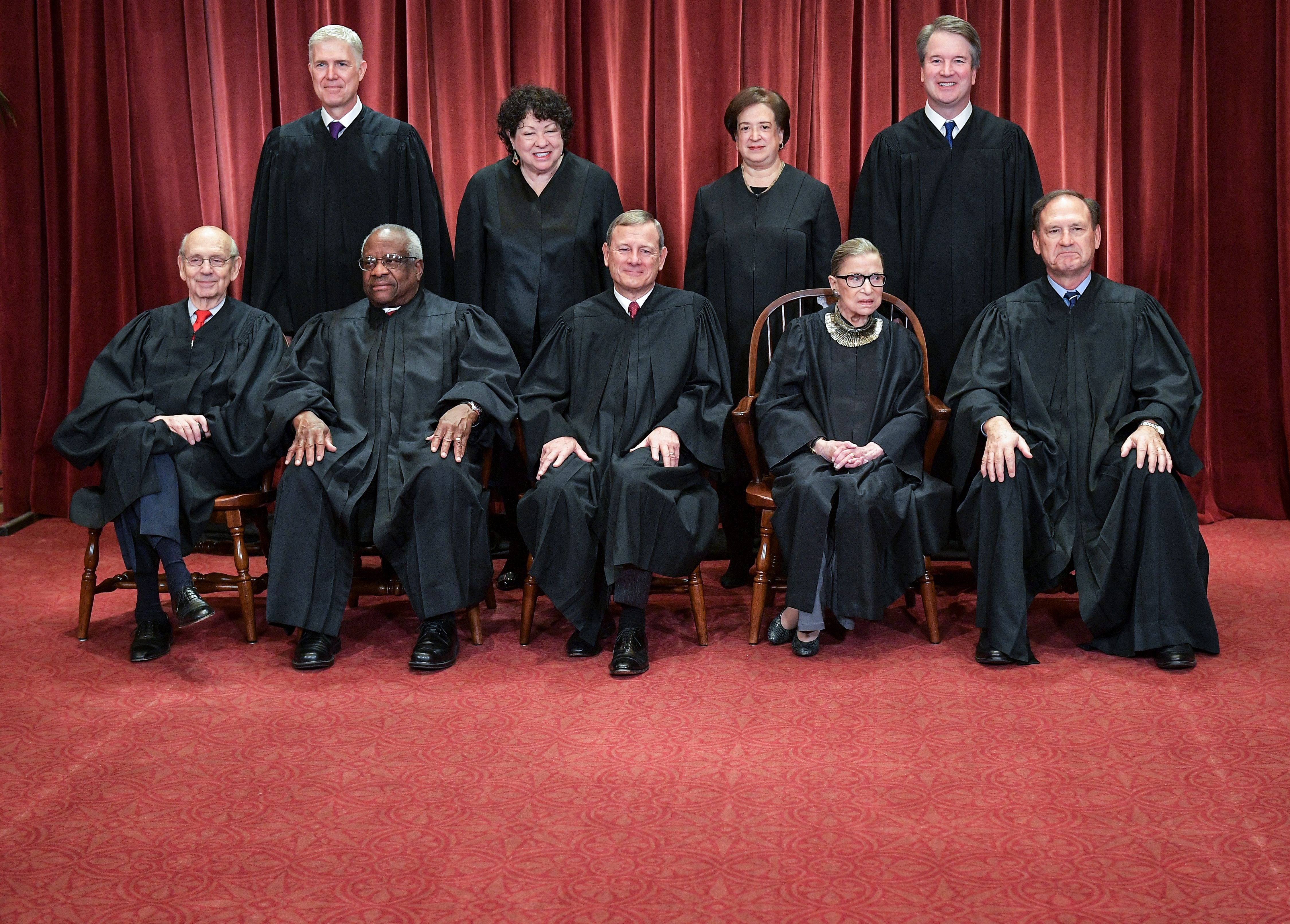 The justices of the Supreme Court pose for their official photo at the Supreme Court in Washington, DC on November 30, 2018. (Mandel Ngan/AFP/Getty Images)