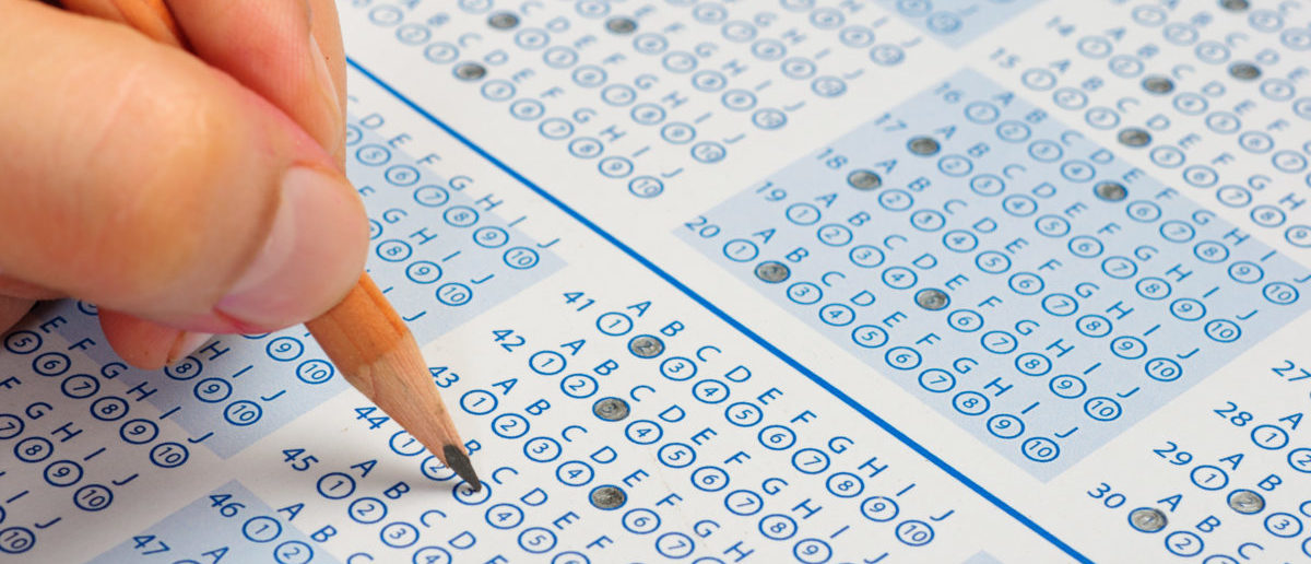 A Harvard alum apologized for taking college entrance exams for students. SHUTTERSTOCK/ Wichy