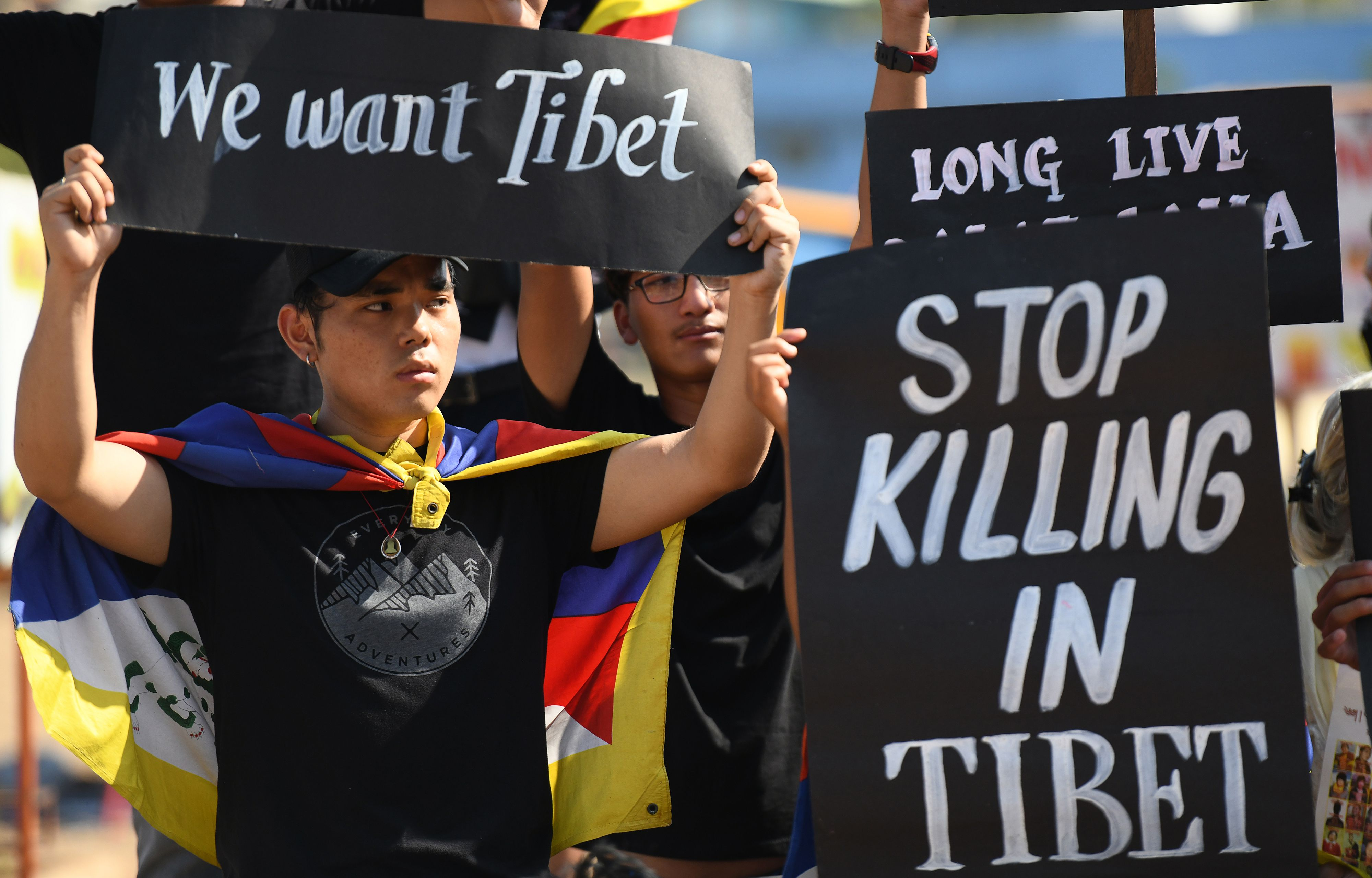 An exiled Tibetan activist holds a placard during a protest marking the 60th anniversary of the 1959 Tibetan uprising against Chinese rule in Chennai on March 10, 2019. (ARUN SANKAR/AFP/Getty Images)