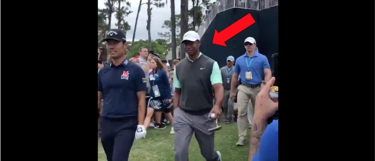 Tigers Woods Holds Back Smile As Man Wears T-Shirt With His Mugshot On It