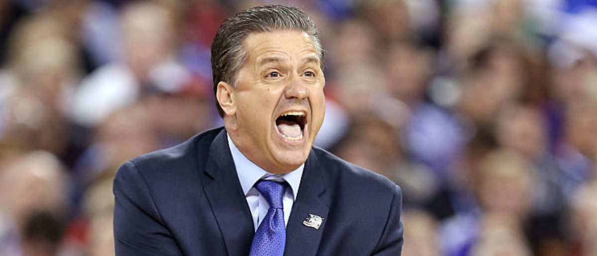 INDIANAPOLIS, IN - APRIL 04: Head coach John Calipari of the Kentucky Wildcats reacts in the first half against the Wisconsin Badgers during the NCAA Men's Final Four Semifinal at Lucas Oil Stadium on April 4, 2015 in Indianapolis, Indiana. (Photo by Andy Lyons/Getty Images)