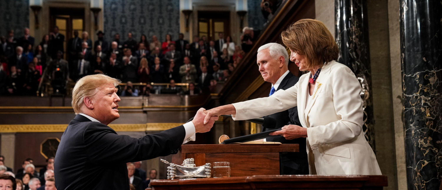WASHINGTON, DC - FEBRUARY 5: U.S. President Donald Trump shakes hands with Speaker of the House Nancy Pelosi while joined by Vice President Mike Pence before delivering the State of the Union address in the chamber of the U.S. House of Representatives at the U.S. Capitol Building on February 5, 2019 in Washington, DC. President Trump's second State of the Union address was postponed one week due to the partial government shutdown. (Photo by Doug Mills-Pool/Getty Images)