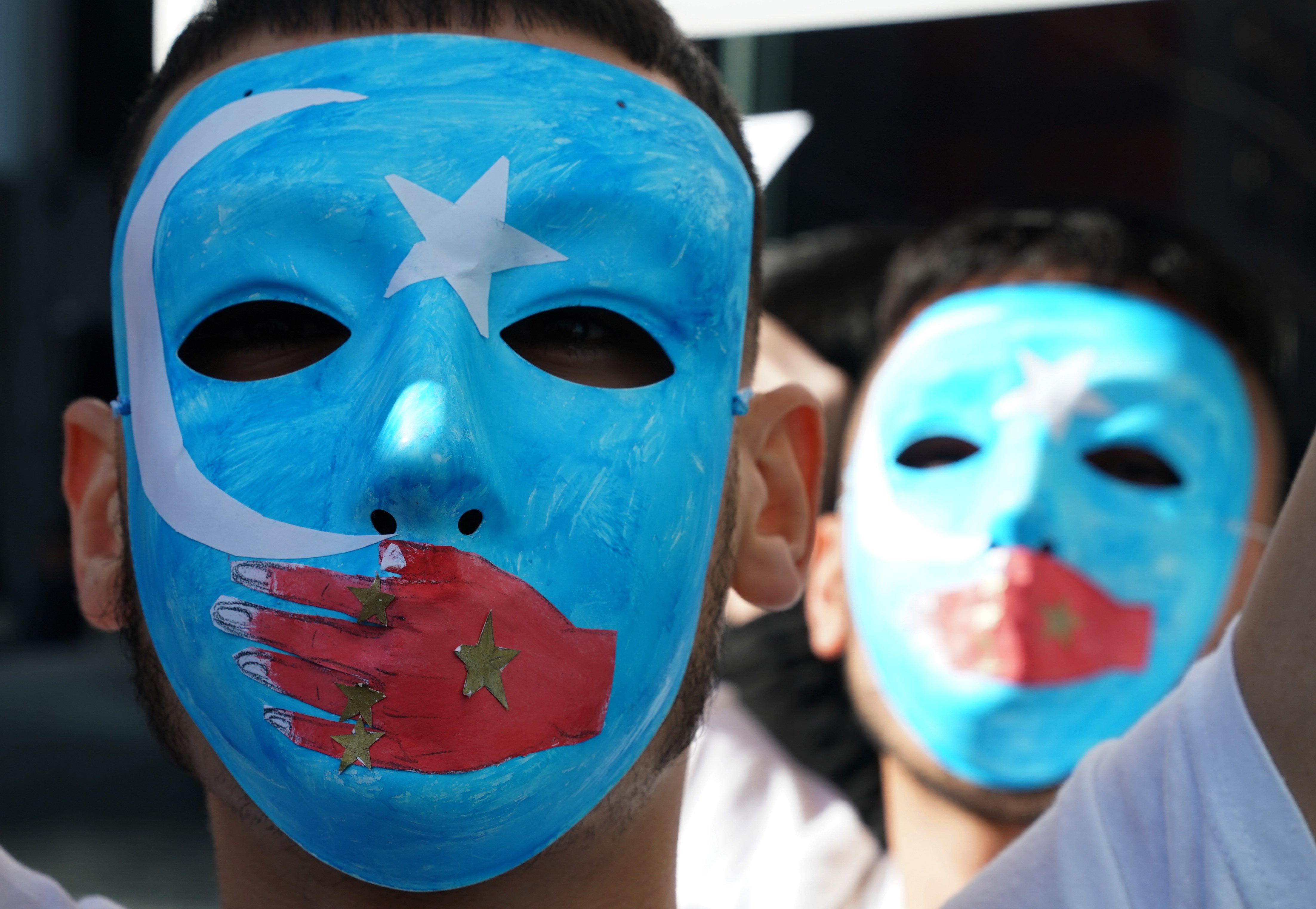 TOPSHOT - People protest at a Uyghur rally on February 5, 2019 in front of the US Mission to the United Nations, to encourage the State Department to fight for the freedom of the majority-Muslim Uighur population unjustly imprisoned in Chinese concentration camps. (TIMOTHY A. CLARY/AFP/Getty Images)