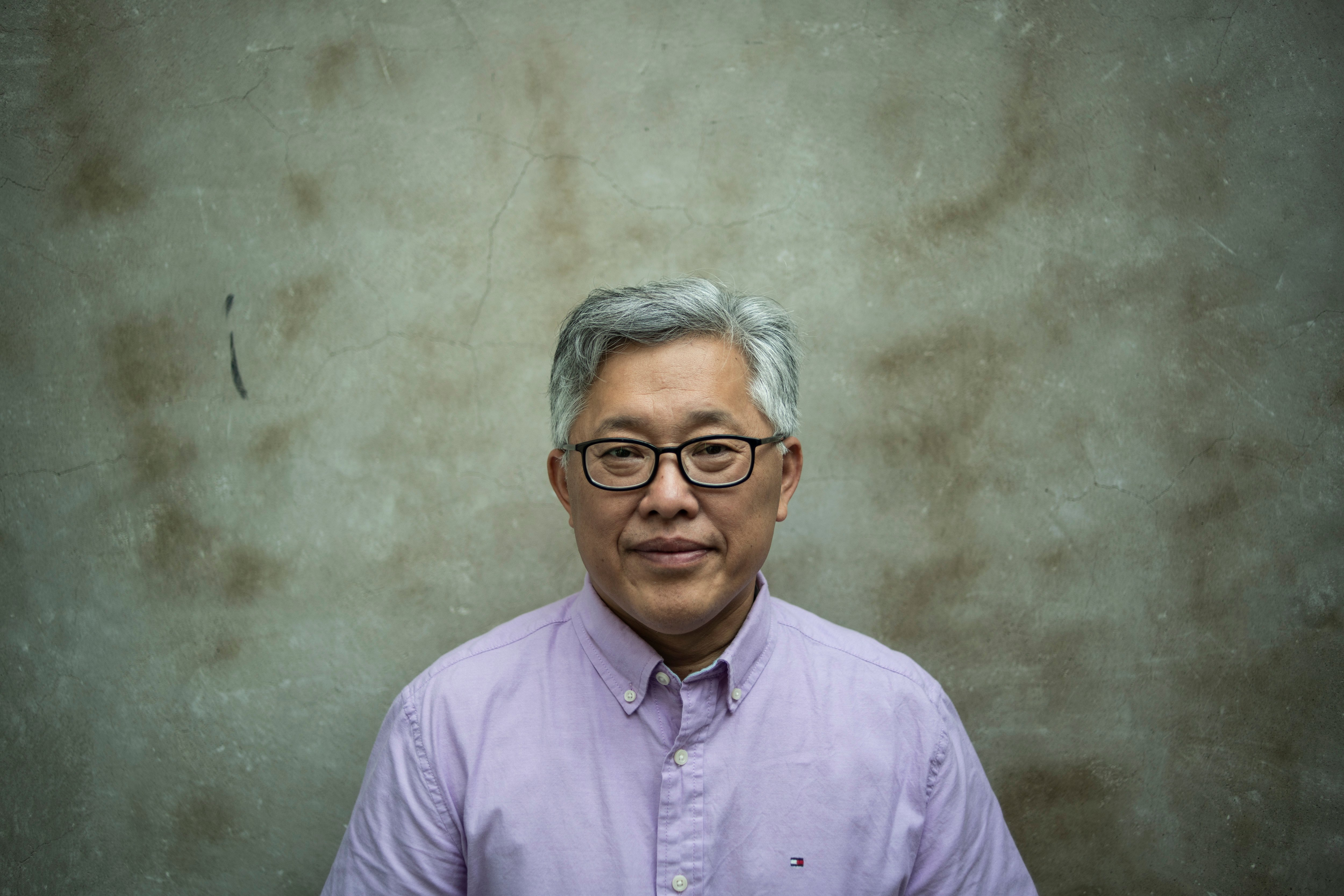 "This photo taken on September 12, 2018 shows Jin Mingri, head pastor of the Zion church, posing in Beijing days after authorities shut down one of China's largest ""underground"" Protestant churches. - A Chinese Protestant pastor is vowing to keep preaching to his flock despite the closure of his prominent underground church in Beijing, defying the government's intensifying pressure on religious groups. (FRED DUFOUR/AFP/Getty Images)"