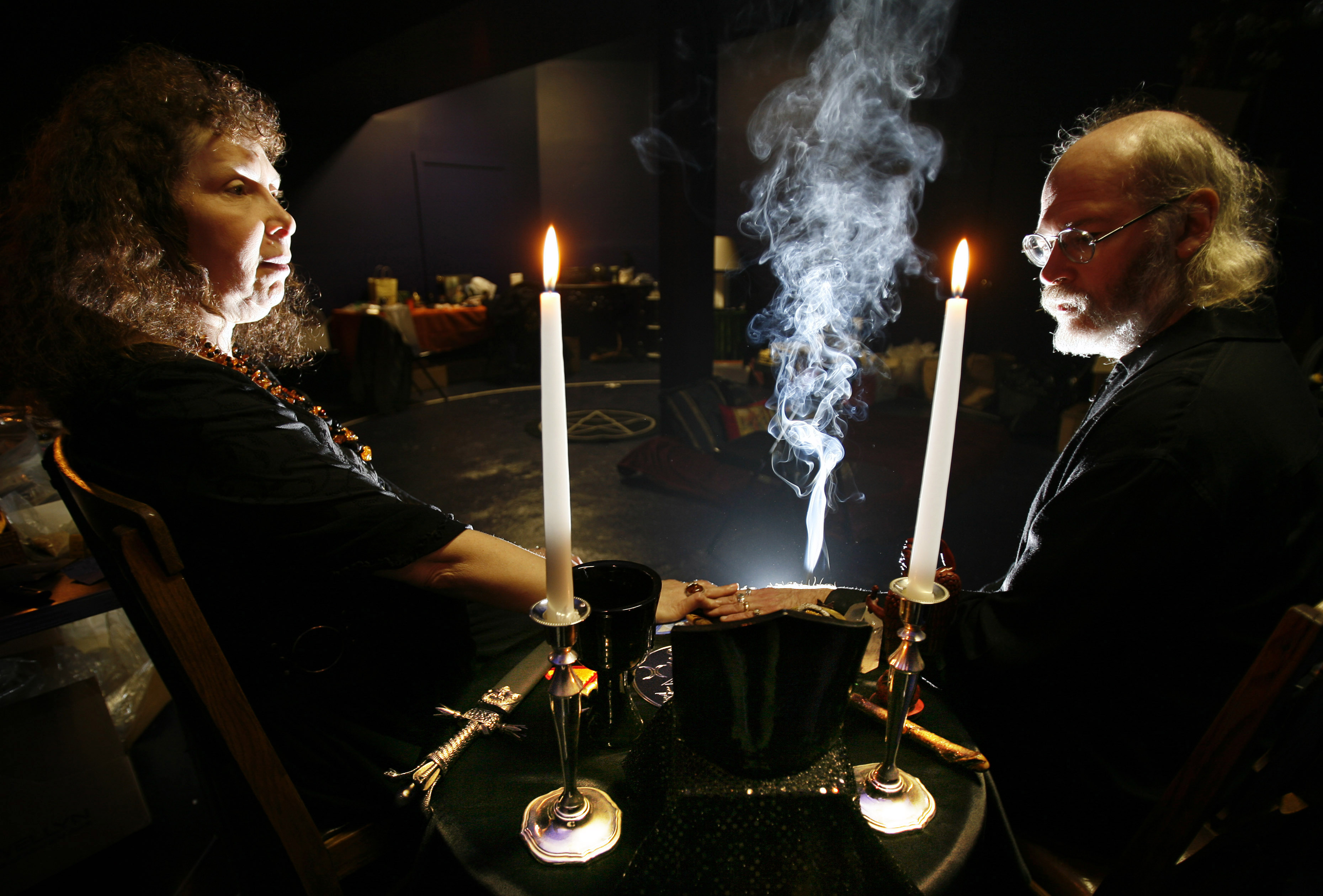 """High priestess and priest Gypsy and Richard Ravish sit at altar dedicated to """"magick"""" in Salem"""