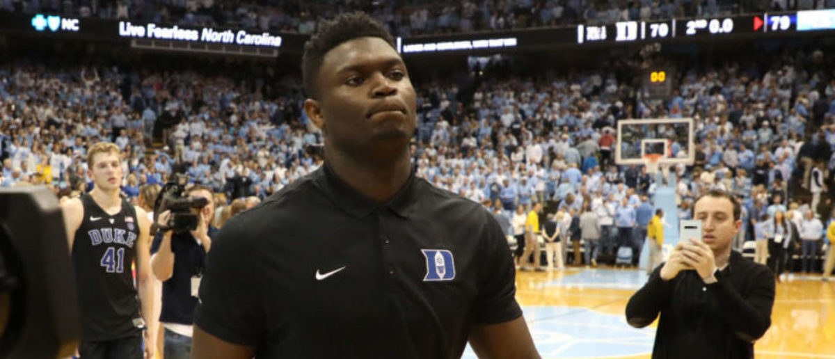 CHAPEL HILL, NORTH CAROLINA - MARCH 09: Zion Williamson #1 of the Duke Blue Devils walks off the court after being defeated by the North Carolina Tar Heels 79-70 after their game at Dean Smith Center on March 09, 2019 in Chapel Hill, North Carolina. (Photo by Streeter Lecka/Getty Images)