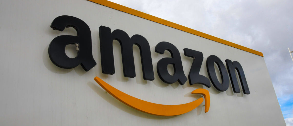 A picture shows the Amazon logo at the entrance area of the Amazon logistics centre in Lauwin-Planque, northern France, on March 4, 2019. (DENIS CHARLET/AFP/Getty Images)