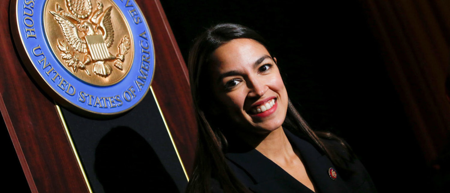 U.S. Rep. Alexandria Ocasio-Cortez (D-NY) poses for pictures at the end of her official swearing-in ceremony in the borough of Bronx, New York, U.S., February 16, 2019. REUTERS/Eduardo Munoz