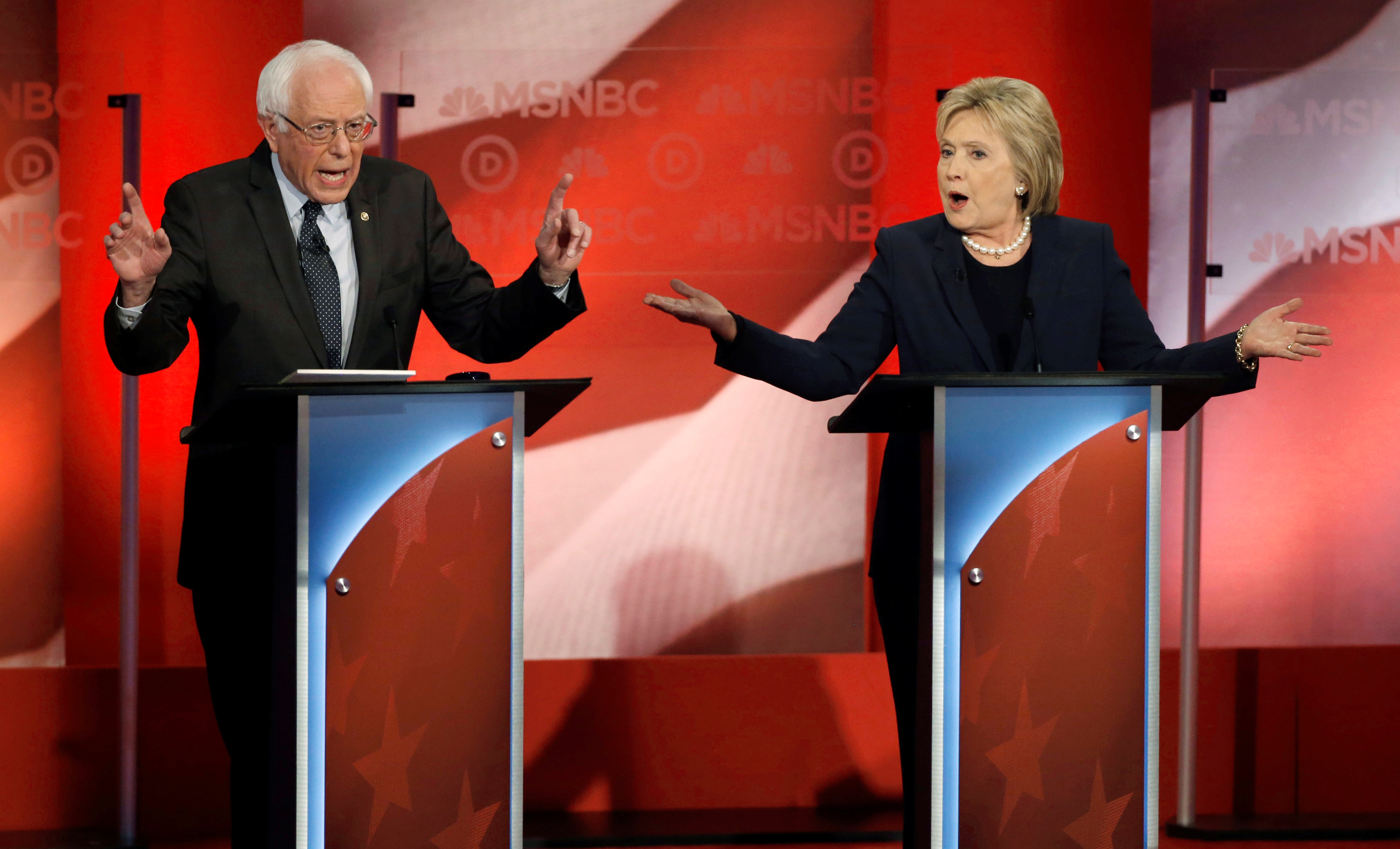Democratic U.S. presidential candidate and Senator Bernie Sanders (L) and former Secretary of State Hillary Clinton speak simultaneously as they discuss issues during the Democratic presidential candidates debate sponsored by MSNBC at the University of New Hampshire in Durham, New Hampshire, U.S., February 4, 2016. REUTERS/Mike Segar /File Photo