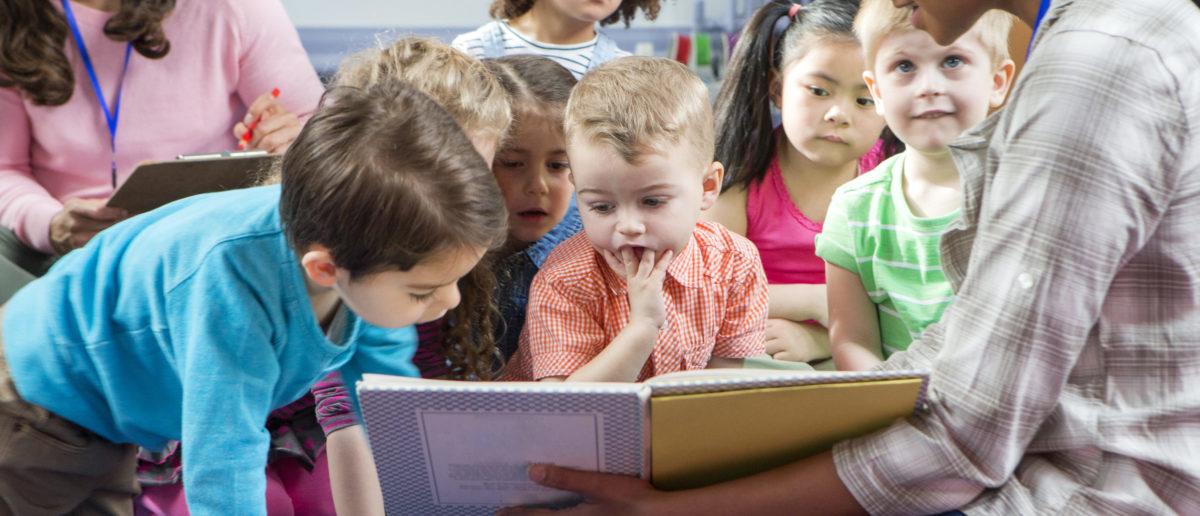 Children listen during storytime. Shutterstock image via user DGLImages