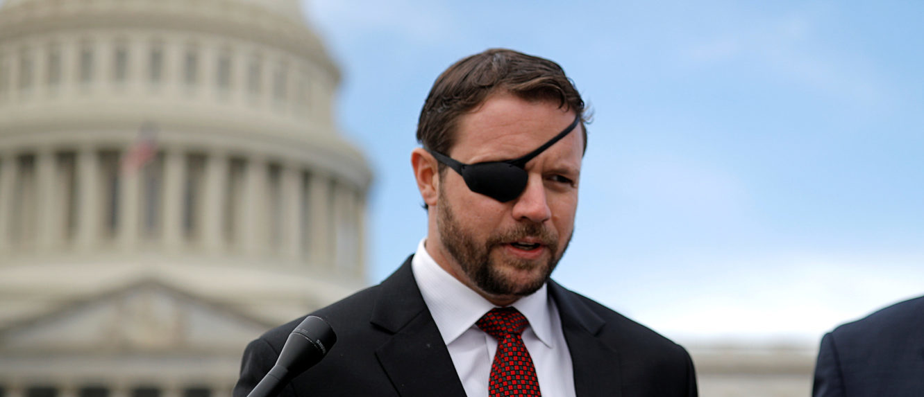 Republican Representative-elect Dan Crenshaw talks with reporters as he arrives for a class photo with incoming newly elected members of the U.S. House of Representatives on Capitol Hill in Washington, U.S., November 14, 2018. REUTERS/Carlos Barria