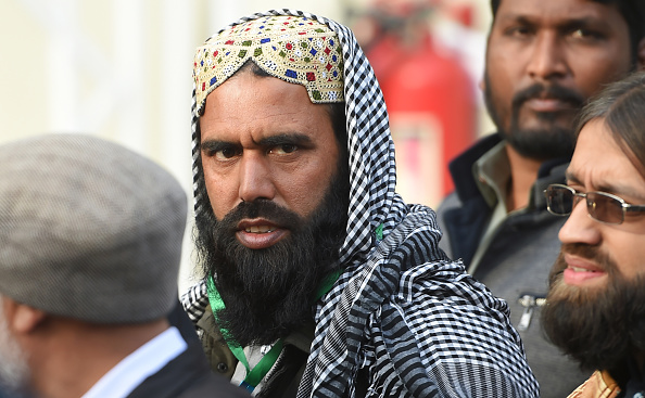 Qari Mohammed Salim, a petitioner against the Asia Bibi case, comes out the Supreme Court building after the court rejected his review appeal, in Islamabad on January 29, 2019. (Photo by FAROOQ NAEEM/AFP/Getty Images)