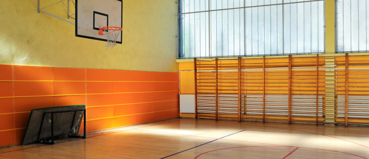 A homeless shelter in a school gym is turning out to be an expensive failure. SHUTTERSTOCK/ dotshock
