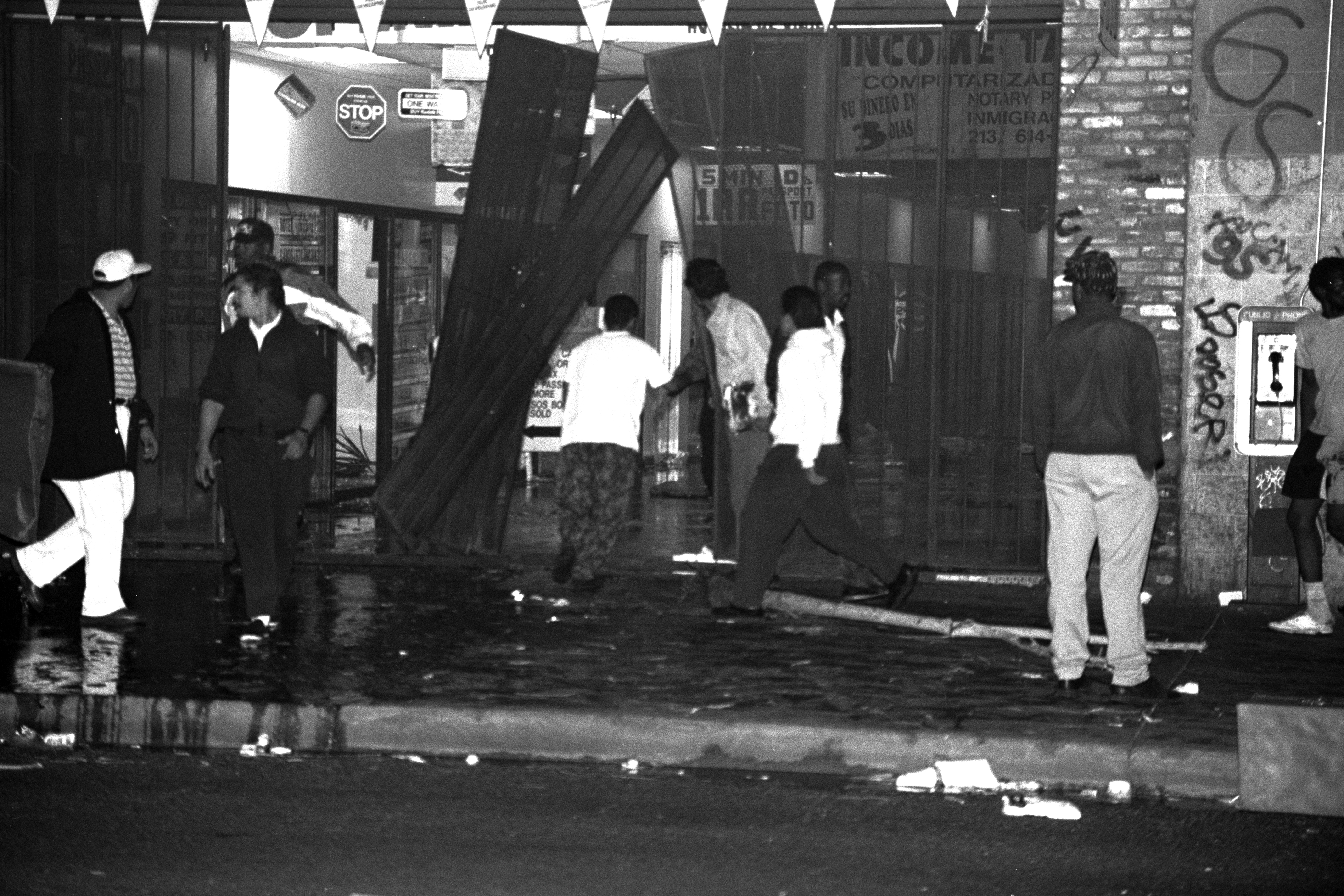 LOS ANGELES, CA - 29 APRIL 1992: Looters tear down storefronts on South Broadway in downtown Los Angeles during night one of the Rodney King Riots on 29 April 1992 in Los Angeles, CA. SHUTTERSTOCK/a katz