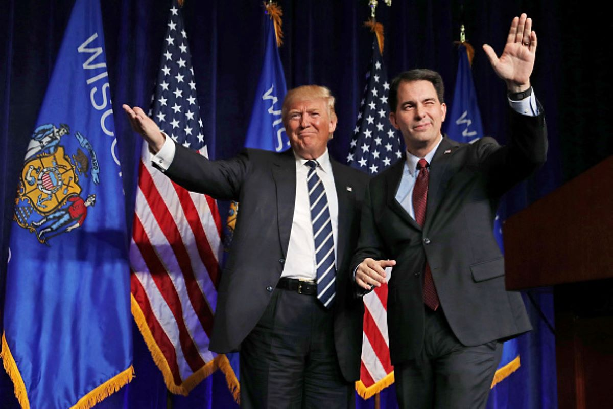 Republican presidential nominee Donald Trump (L) is welcomed to the stage by Wisconsin Governor Scott Walker during a campaign rally at the W.L. Zorn Arena November 1, 2016 in Altoona, Wisconsin. (Photo by Chip Somodevilla/Getty Images)