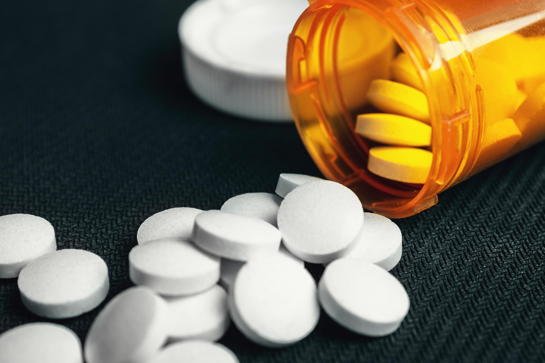 A bottle of pills is overturned. Shutterstock image via user DedMityay